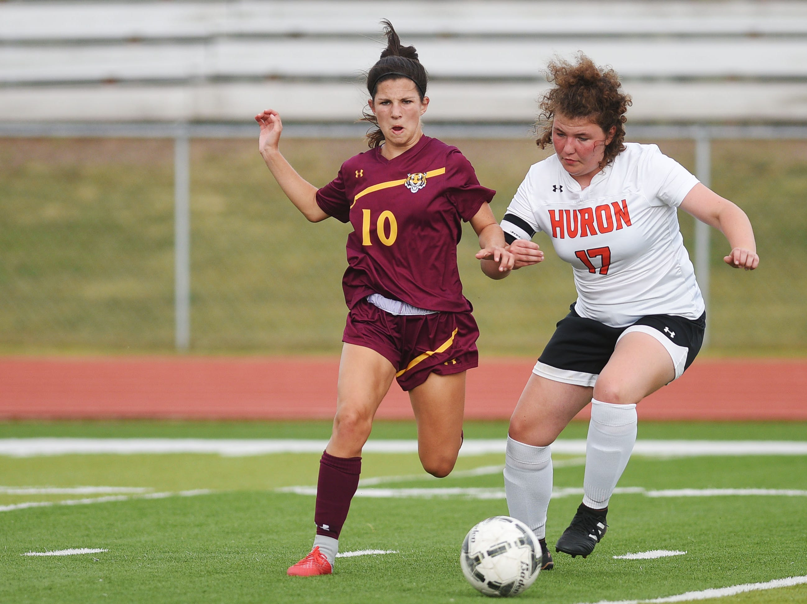 Harrisburg's Brooklyn Schimoeller goes against Huron's  Shelbey Hershman during the game Thursday, Sept. 13, at Harrisburg.