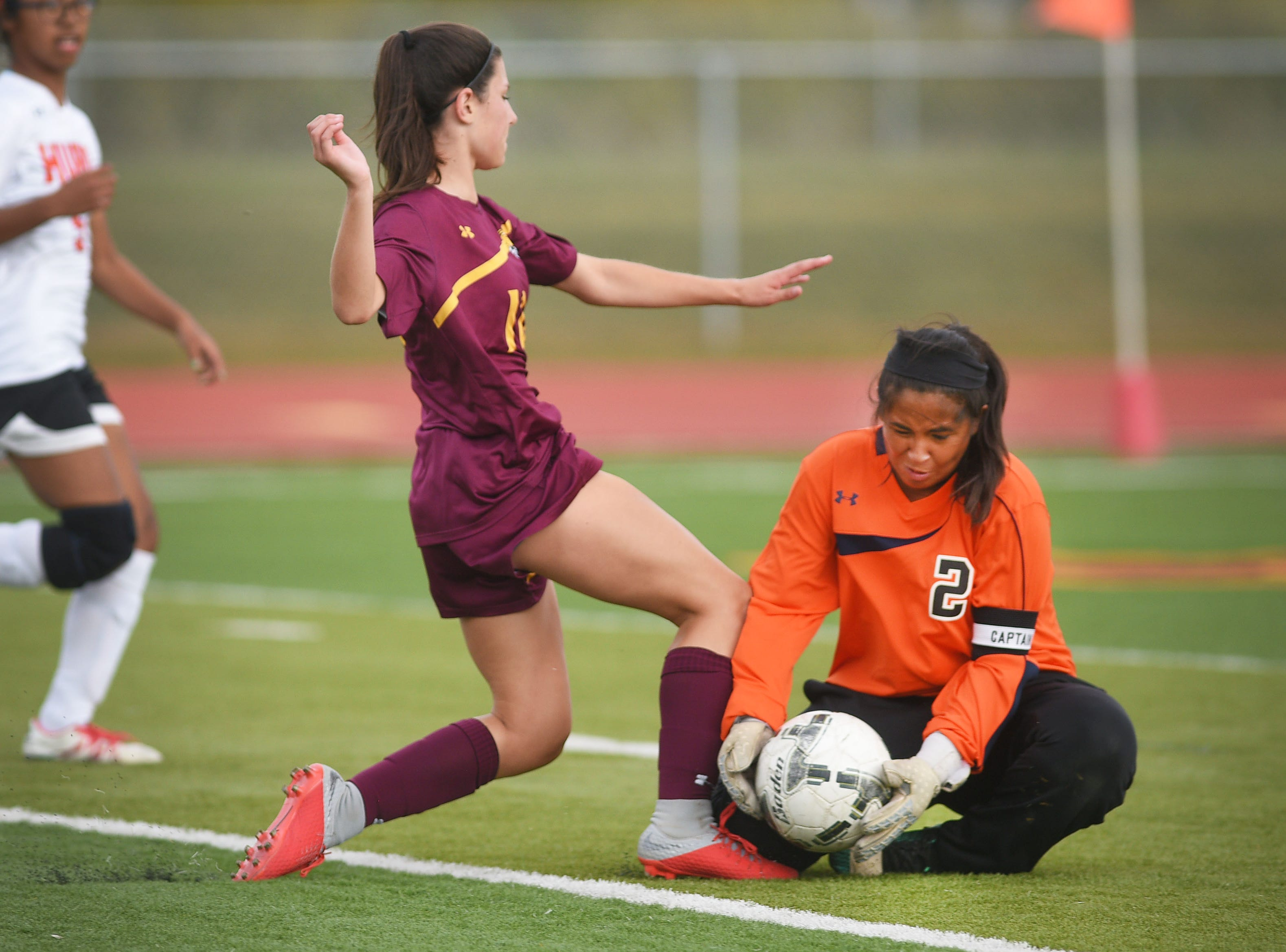 Harrisburg's Brooklyn Schimoeller goes against Huron's 	Fatima Reyes during the game Thursday, Sept. 13, at Harrisburg.