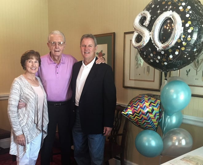 """Carol Mullins, Jim Morris and H. Azell """"Butch"""" Morris, from left, celebrate 80 years of Morris Loan and Investment at Hickory Hills Country Club in late August. The company was launched by family patriarch H. Azell Morris in 1938."""