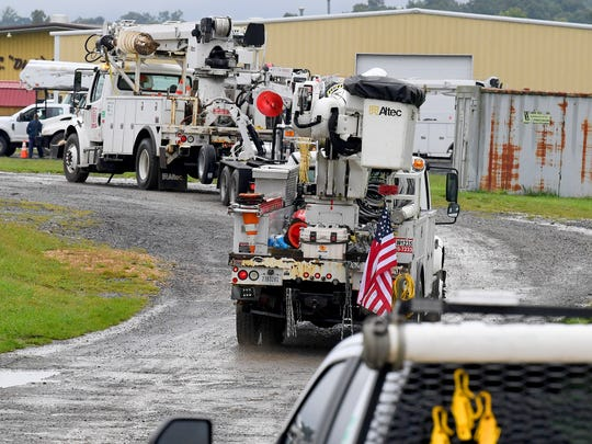An American flag adorns the back of one utility trucks arriving at Augusta Expo, which is serving as a storm staging area for crews arriving from several on Friday, Sept. 14, 2018. They stand ready to be dispatched to assist as needed in association with Hurricane Florence.