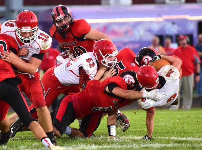 Riverheads' Devin Morris, right, is taken down by a host of East Rockingham defenders during their Shenandoah District football game on Thursday, Sept. 13 ,2018, at East Rockingham High School in Elkton, Va.