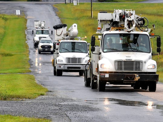 More utility trucks approach Augusta Expo, which is serving as a storm staging area for crews arriving from several on Friday, Sept. 14, 2018. They stand ready to be dispatched to assist as needed in association with Hurricane Florence.