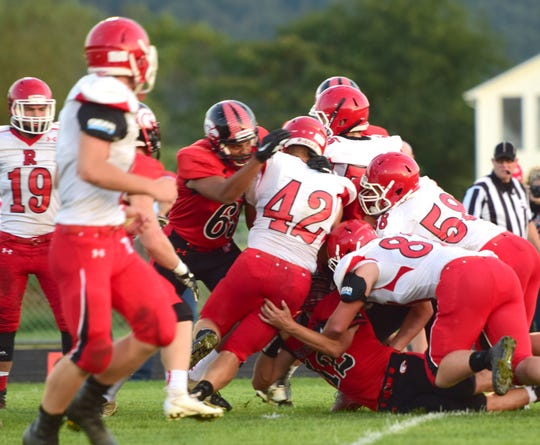 Riverheads fullback Moose Lee is stopped at the line of scrimmage by East Rockingham's Octavius Brown during the first half of their Shenandoah District football game on Thursday, Sept. 13, 2018, at East Rockingham High School in Elkton, Va.