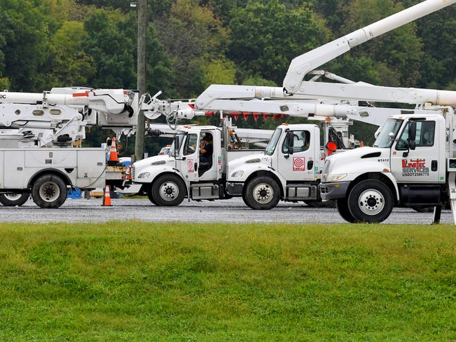 Utility trucks fill the parking lot at Augusta Expo as crews from several states gather at the storm recovery staging area on Friday, Sept. 14, 2018. They stand ready to be dispatched to assist as needed in association with Hurricane Florence.
