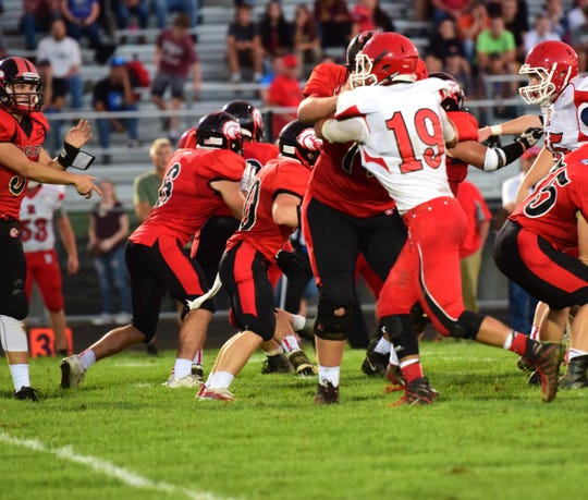 Riverheads defensive end Forrest Shuey is blocked by East Rockingham's Logan Dofflemyer on a pass play during the first half of their Shenandoah District football game on Thursday, Sept. 13, 2018, at East Rockingham High School in Elkton, Va.