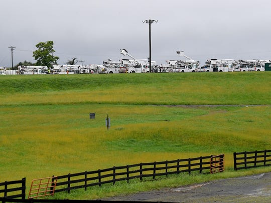 A mass of utility trucks filling the parking lot at Augusta Expo are viewed from the interstate. Crews from several states gather at the storm recovery staging area on Friday, Sept. 14, 2018. They stand ready to be dispatched to assist as needed in association with Hurricane Florence.