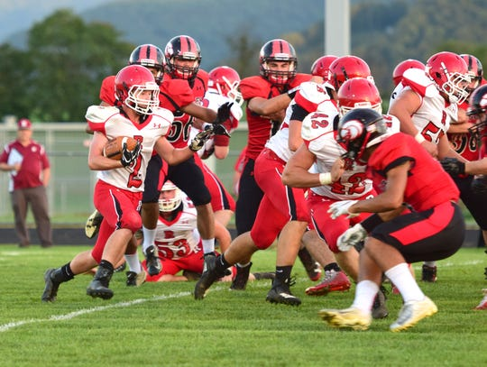 Riverheads' Devin Morris, left, runs into the teeth of East Rockingham's defense during their Shenandoah District football game on Thursday, Sept. 13 ,2018, at East Rockingham High School in Elkton, Va.