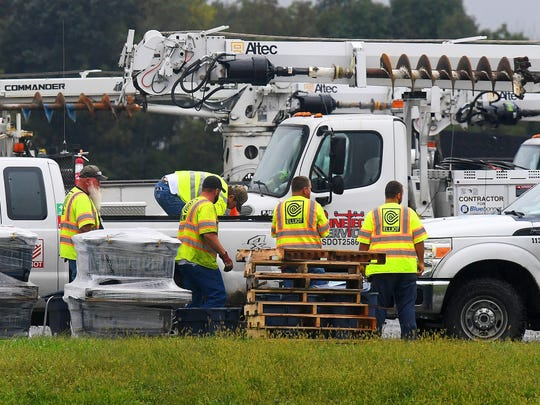Utility trucks and crews from several states gather at Augusta Expo, which serves as a central staging area for them on Friday, Sept. 14, 2018. They stand ready to be dispatched to assist as needed in association with Hurricane Florence.