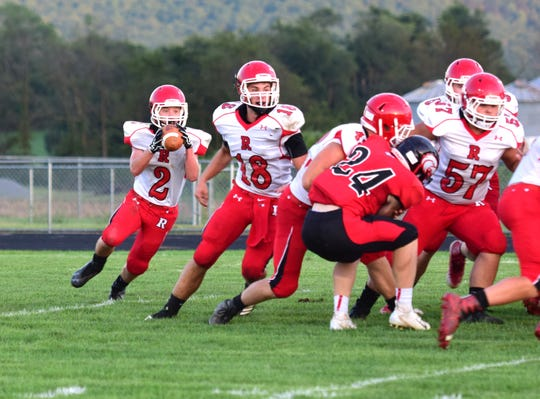 Riverheads running back Devin Morris, left, takes the pitch from quarterback Justin McWhorter, who Thursday, Sept. 13, 2018, at East Rockingham High School in Elkton, Va.