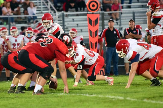 Riverheads' defense waits for East Rockingham's offense to snap the ball during the first half of their Shenandoah District football game on Thursday, Sept. 13, 2018, at East Rockingham High School in Elkton, Va.