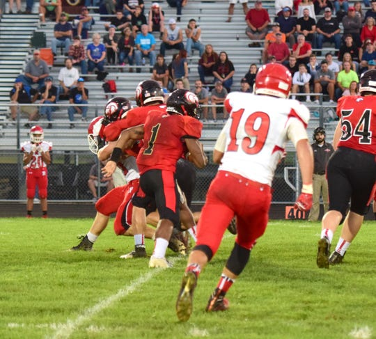 East Rockingham's J'wan Evans, center, breaks out of the backfield against Riverheads during the first half of their Shenandoah District football game on Thursday, Sept. 13, 2018, at East Rockingham High School in Elkton, Va.