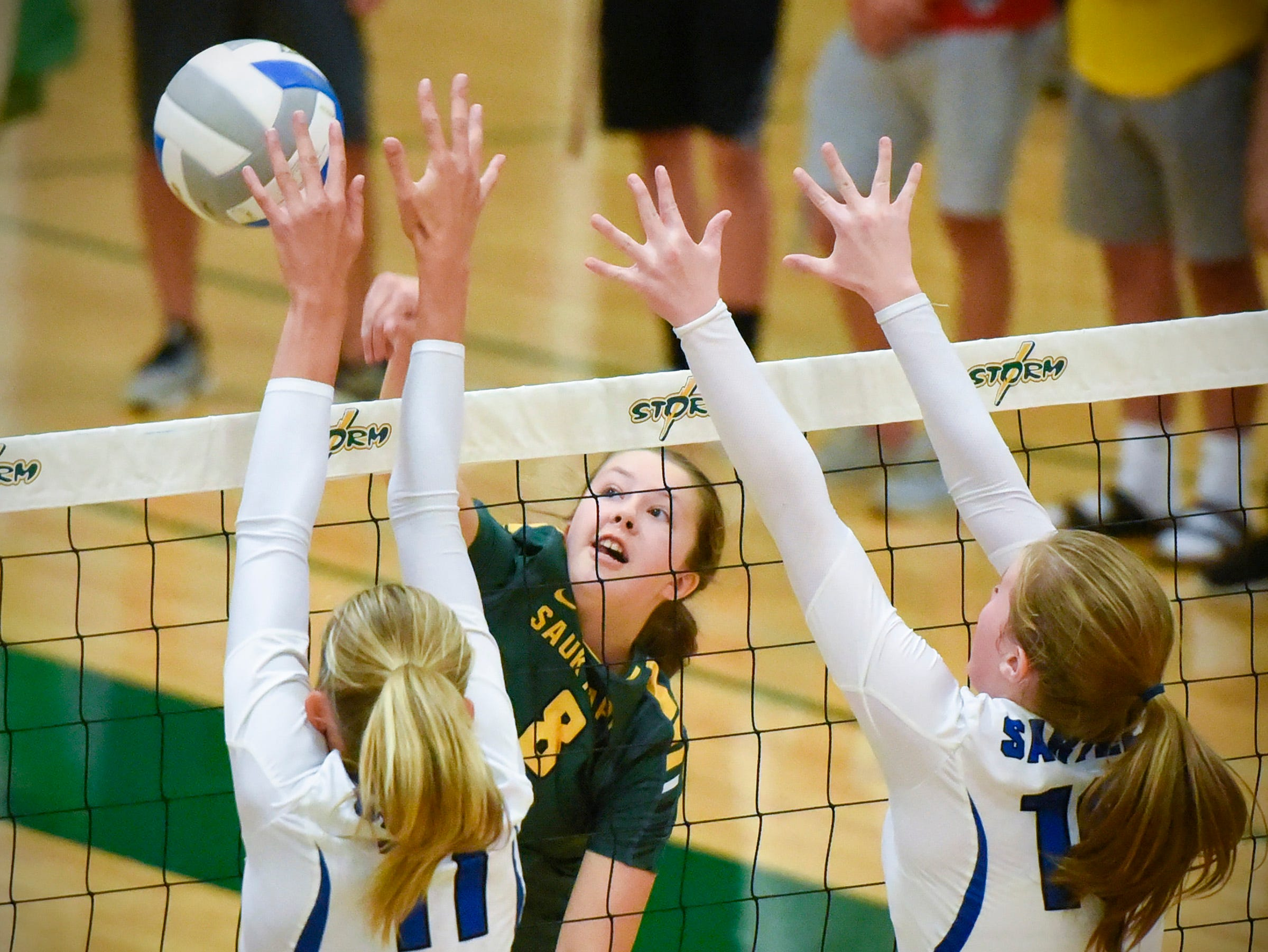 Sauk Rapids' Cora Weirens spikes the ball at the net against Sartell during the first game Thursday, Sept. 13, at Sauk Rapids.