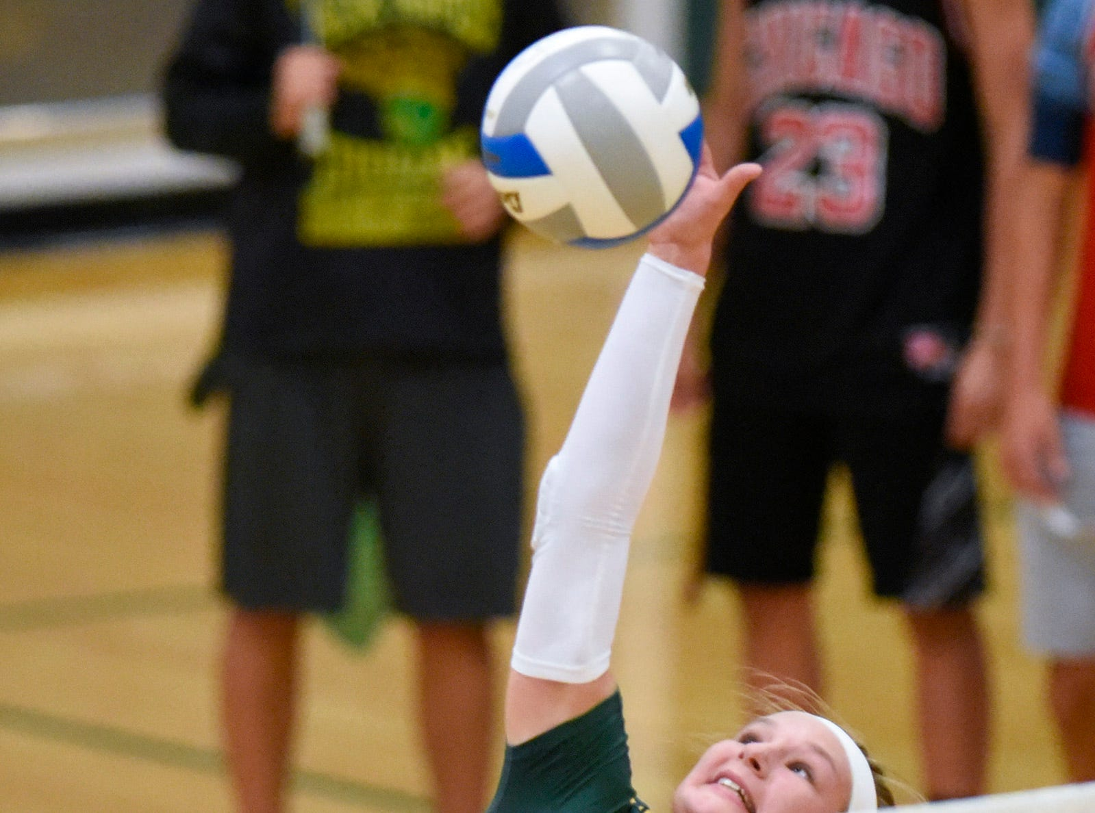 Sauk Rapids' Morgan Maselter goes high for a spike against Sartell during the first game Thursday, Sept. 13, at Sauk Rapids.