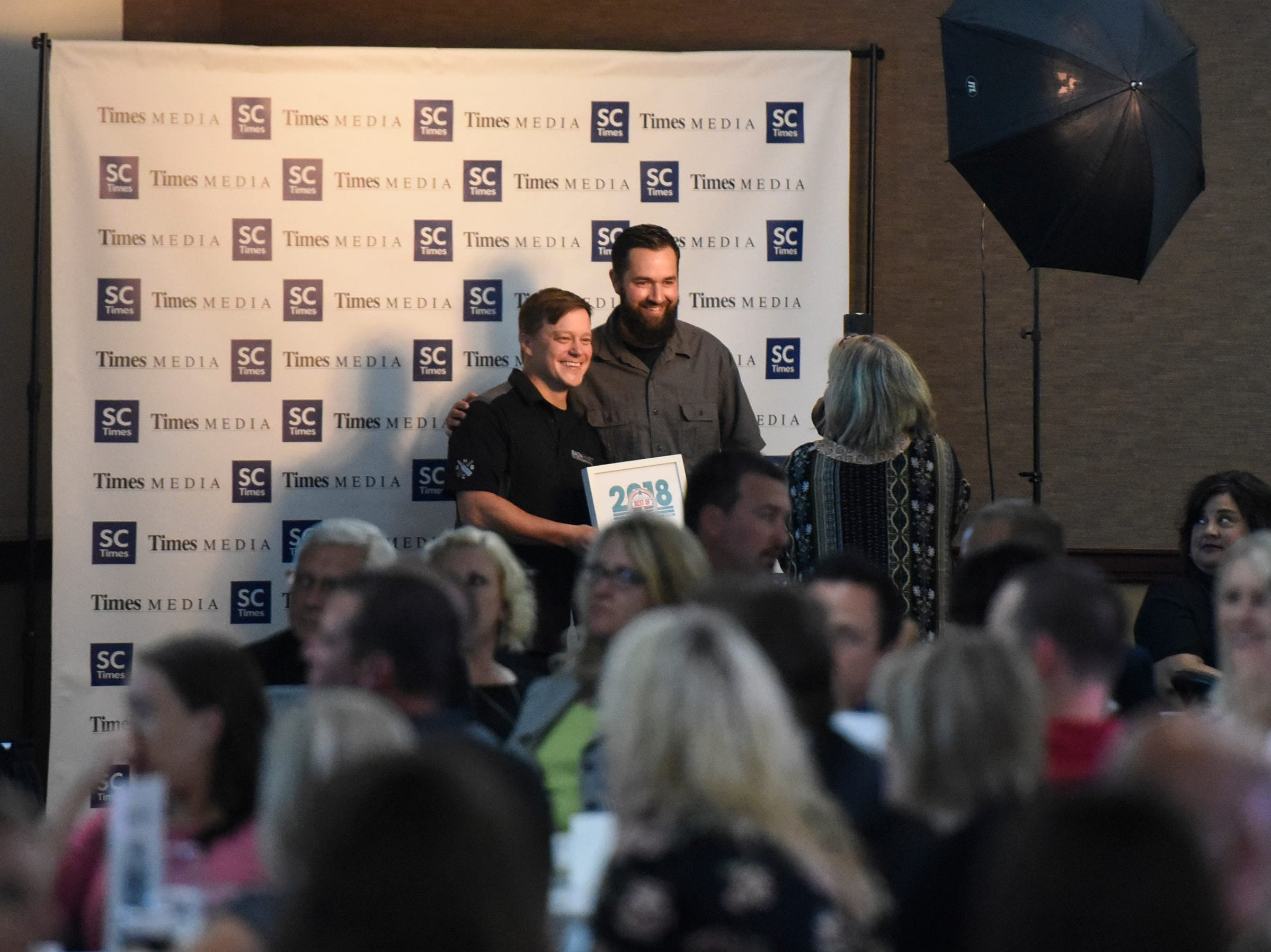 Eric Geier and Aaron Rieland accept an award for Bad Habit Brewery during the Best of Central Minnesota awards ceremony Thursday, Sept. 13, in St. Joseph.