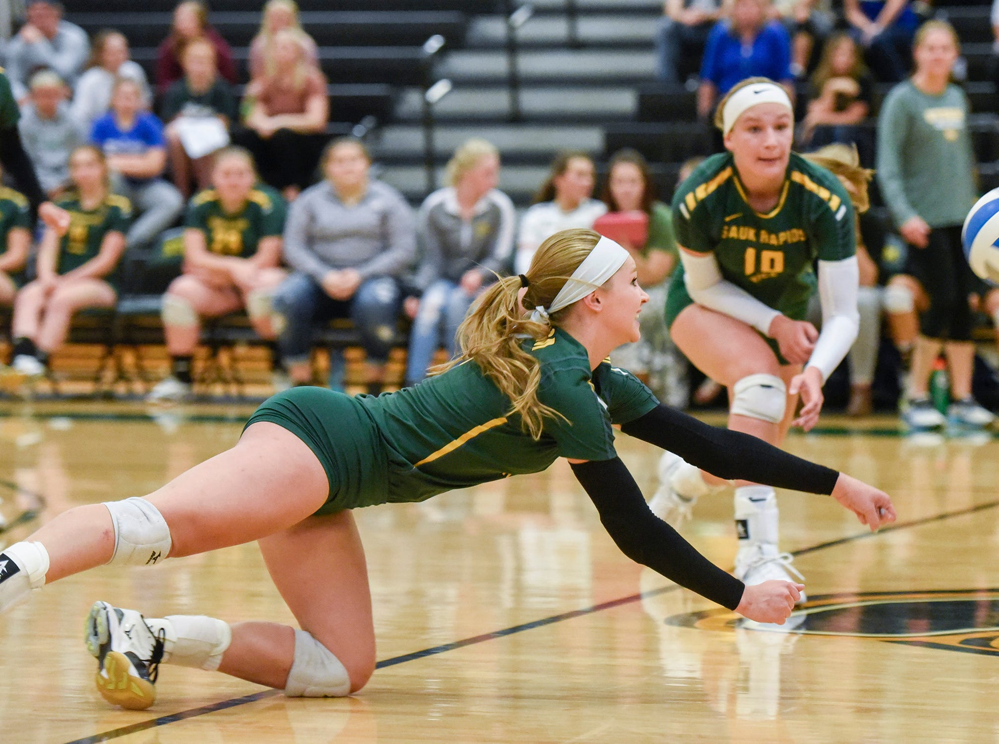 Sauk Rapids' Bailey Roscoe dives for a ball against Sartell during the second game Thursday, Sept. 13, at Sauk Rapids.