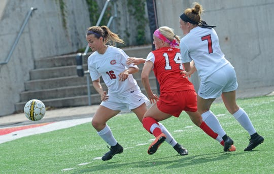 St. Cloud State senior defender Sara Magno (16) tries to get to the ball in front of MSU-Moorhead's Marie Griffith (14) and teammate Brooke Bares (7) in a game on on Sept. 24, 2017, at Husky Stadium.