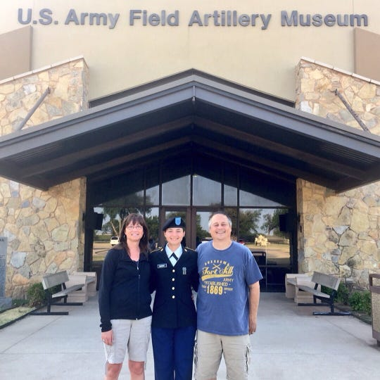 St. Cloud State senior soccer player Sara Magno (center) with her parents, Debbie (left) and Kevin, in front of the U.S. Army Field Artillery Museum at Fort Sill, Oklahoma. Sara is in the ROTC and plans on being a doctor in the Army.