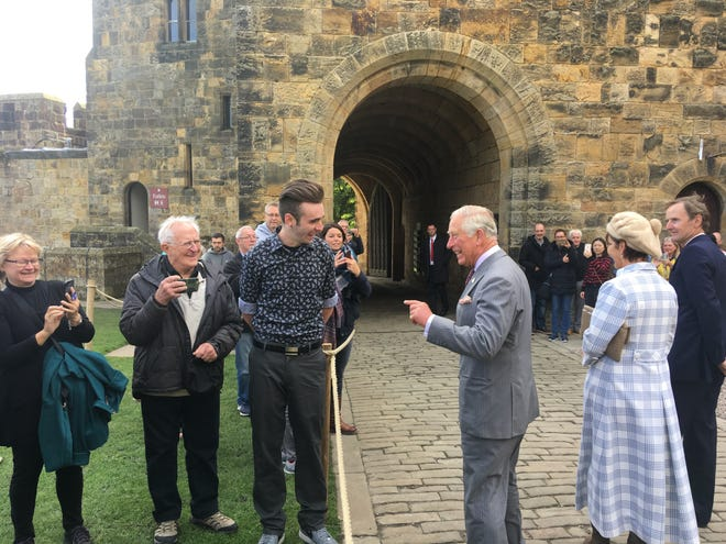 Prince Charles speaks with Gabriel Legierski, of Ham Lake, at Alnwick Castle in Northumberland in Northern England. Legierski is one of six students who met the prince while studying abroad through St. Cloud State University.