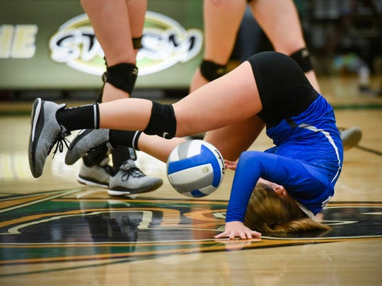 Sartell's Hope Grasswick dives for a ball during a match against Sauk Rapids   during the second game Thursday in Sauk Rapids.