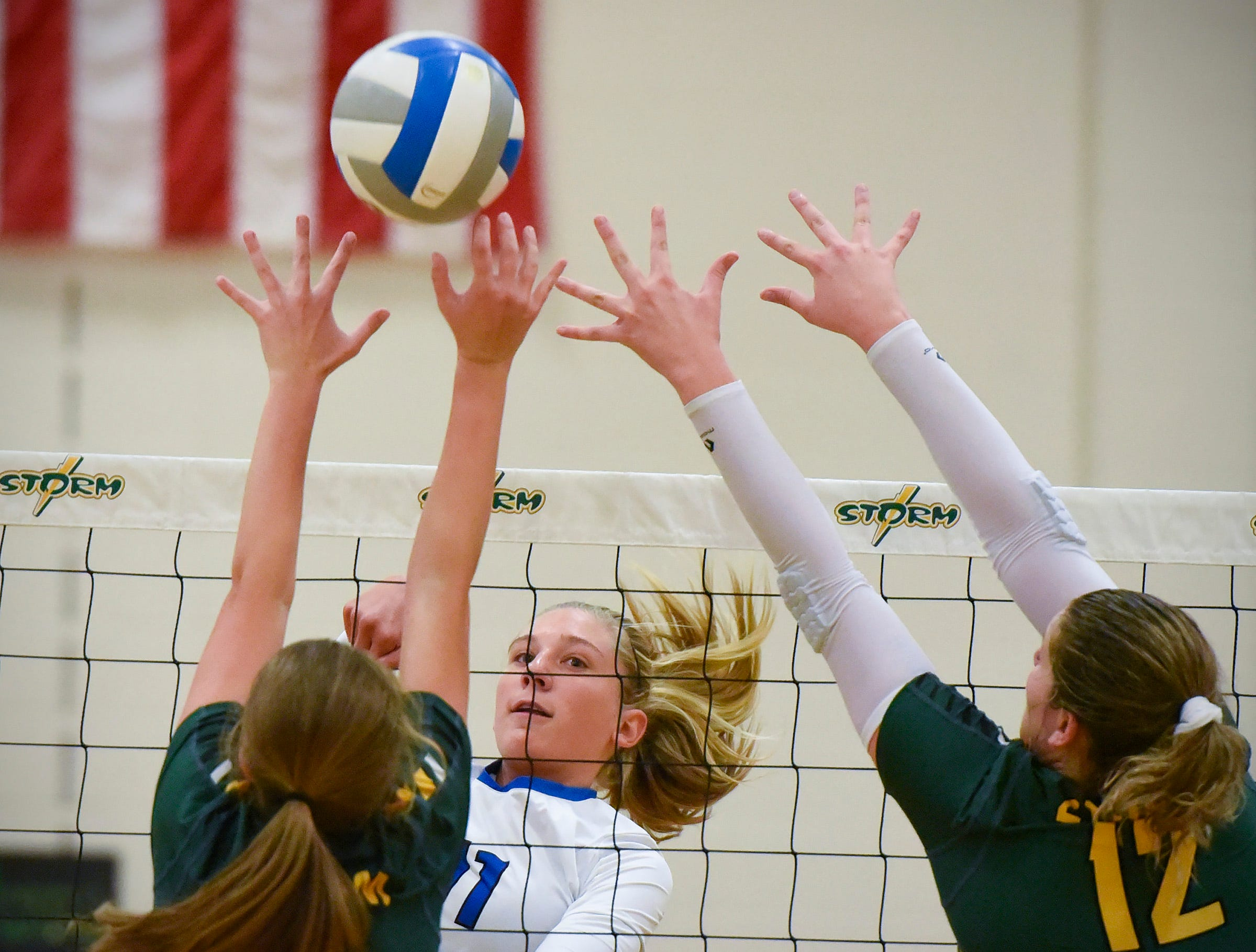 Sartell's Katelyn Hammer spike the ball against Sauk Rapids during the second game Thursday, Sept. 13, at Sauk Rapids.