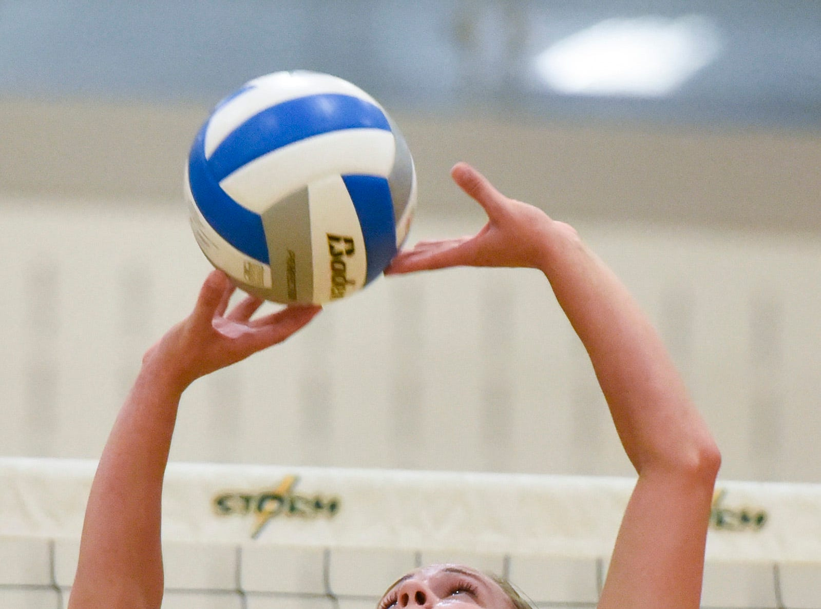 Sauk Rapids' Staci Meher sets the ball against Sartell during the second game Thursday, Sept. 13, at Sauk Rapids.