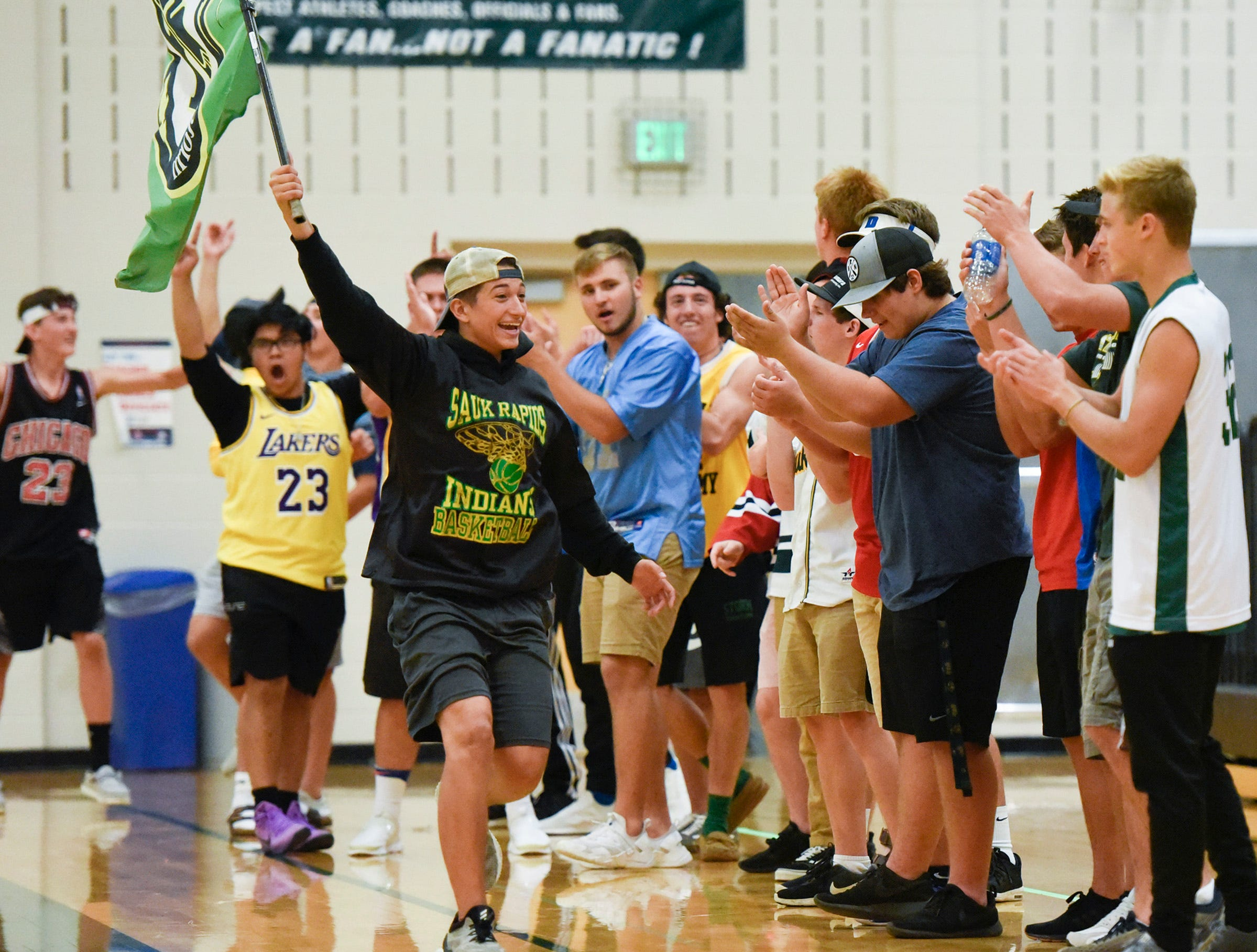 Sauk Rapids' fans celebrate a point against Sartell.