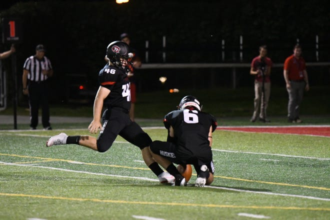 St. Cloud State's Adam Stage (46) kicks a PAT at Husky Stadium. Stage, a sophomore from Appleton, Wisconsin, was an All-NSIC North Division first team pick last season and has made his last four field goals after missing three in the opener.