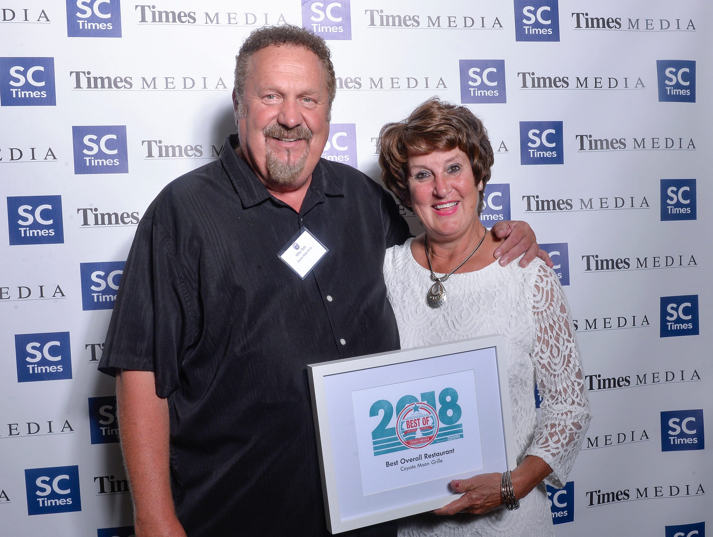 Mike and Mar Dols accept the Best Overall Restaurant award for Coyote Moon during the Best of Central Minnesota awards ceremony Thursday, Sept. 13, in St. Joseph.