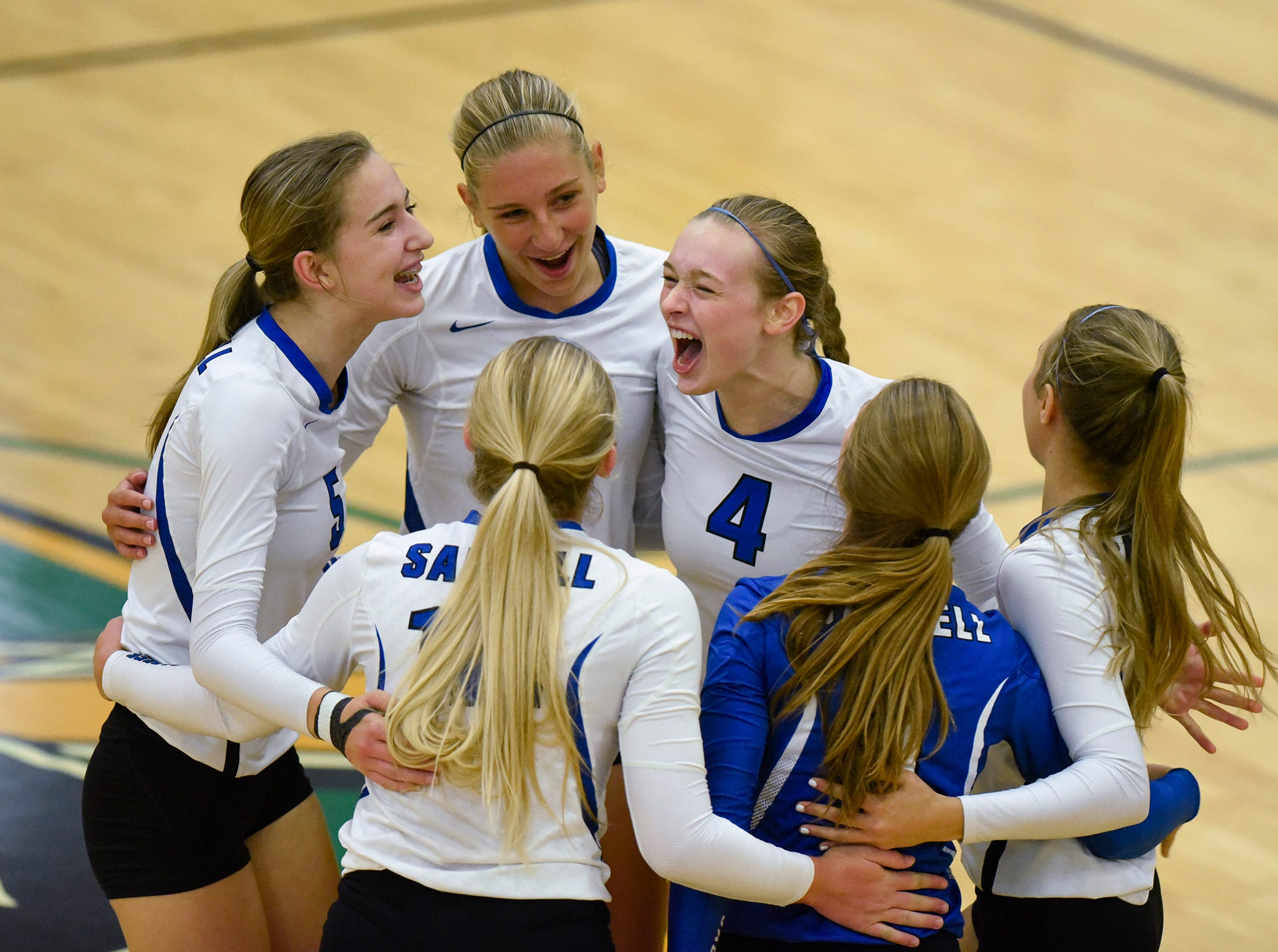 Sartell players celebrate a point against Sauk Rapids during the first game Thursday, Sept. 13, at Sauk Rapids.