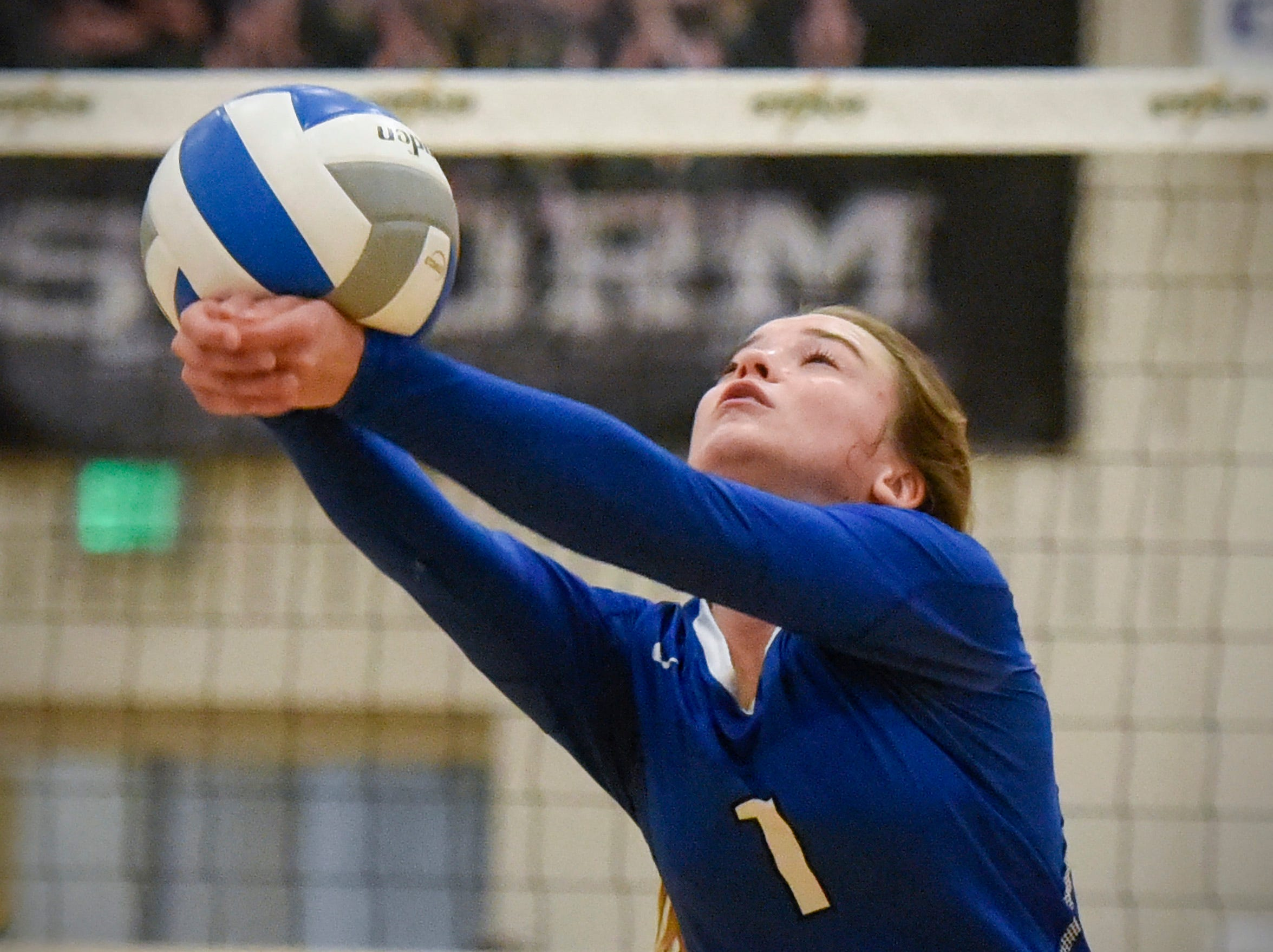 Sartell's Hope Grasswick bumps the ball up toward the net against Sauk Rapids during the first game Thursday, Sept. 13, at Sauk Rapids.