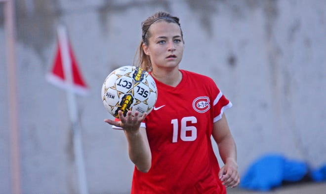 St. Cloud State senior defender Sara Magno looks to throw the ball in for the soccer team. Magno is a pre-med student and is in the ROTC. She wants to be a doctor in the Army.