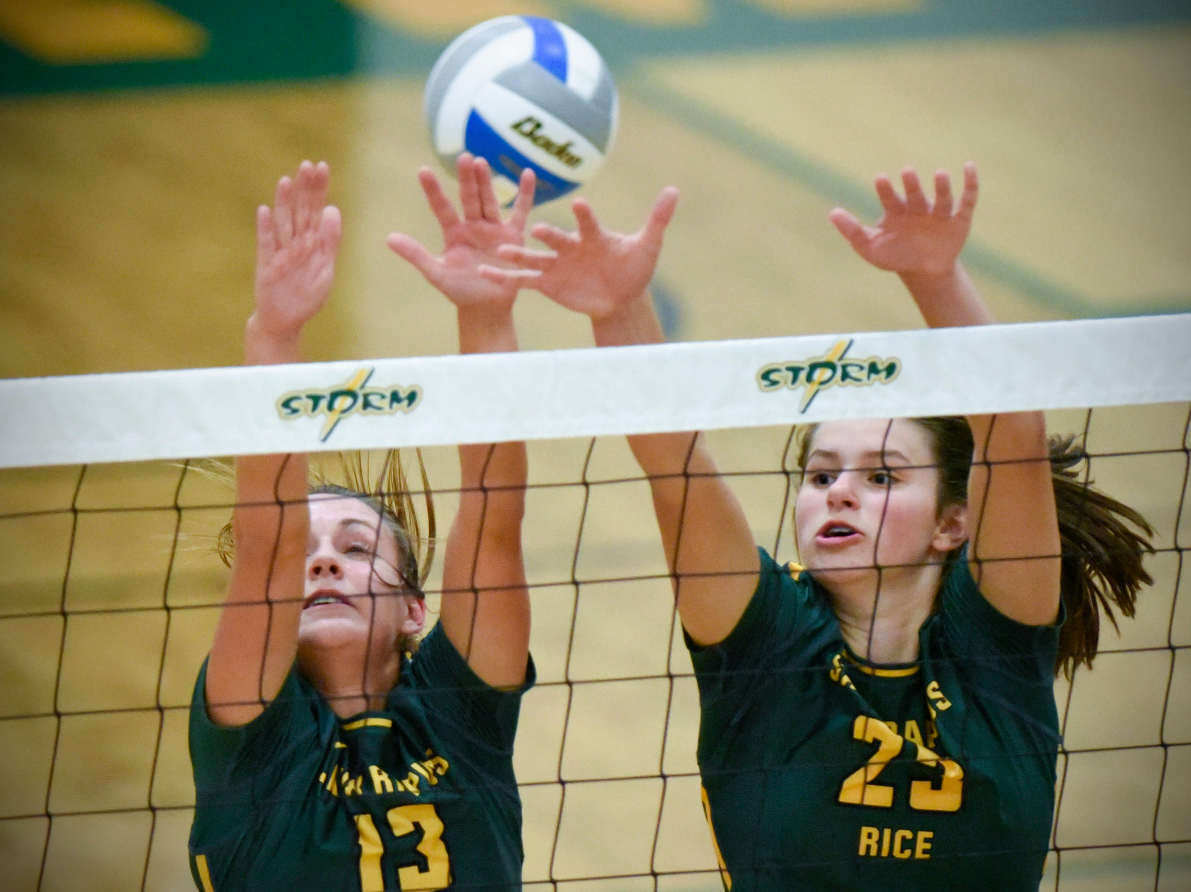 Sauk Rapids' Staci Meyer and Darci Peterson go up to block a spike against Sartell during the first game Thursday, Sept. 13, at Sauk Rapids.