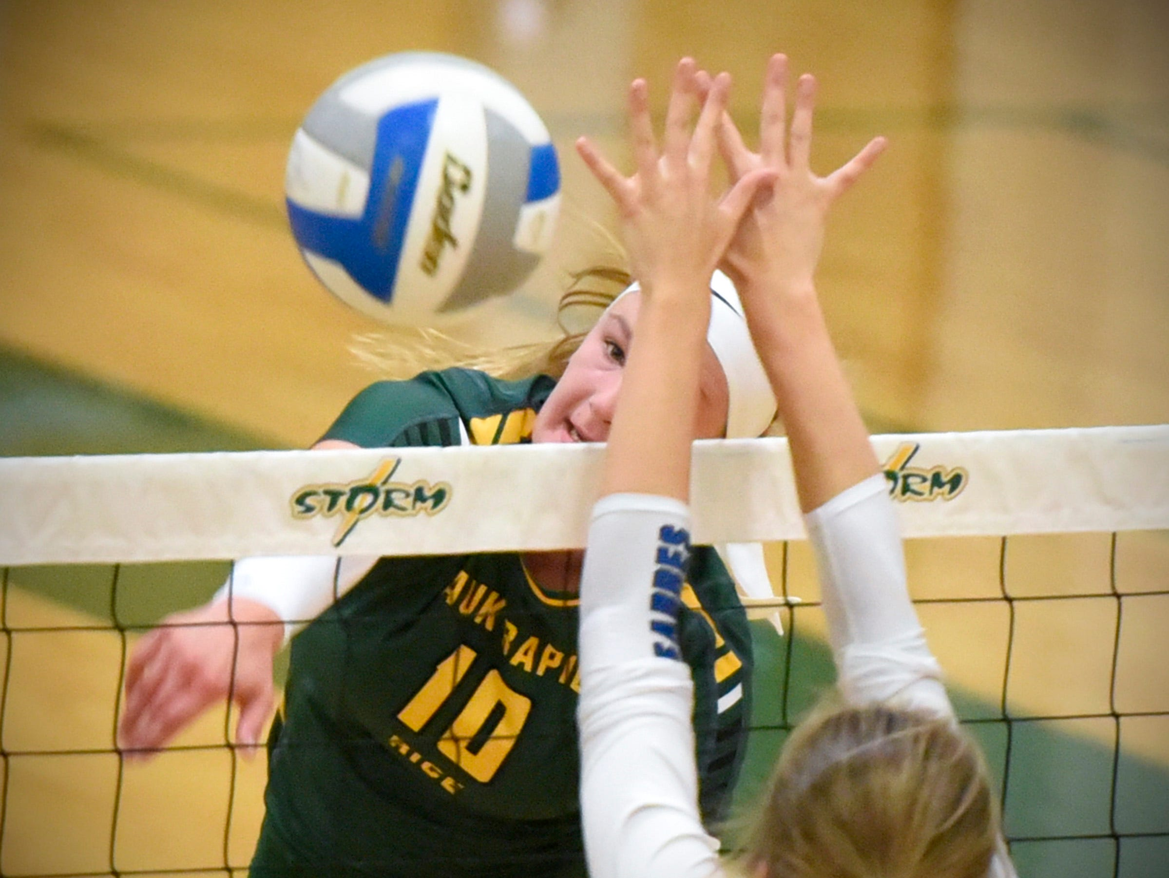 Sauk Rapids' Morgan Maselter spikes the ball over the net against Sartell during the first game Thursday, Sept. 13, at Sauk Rapids.