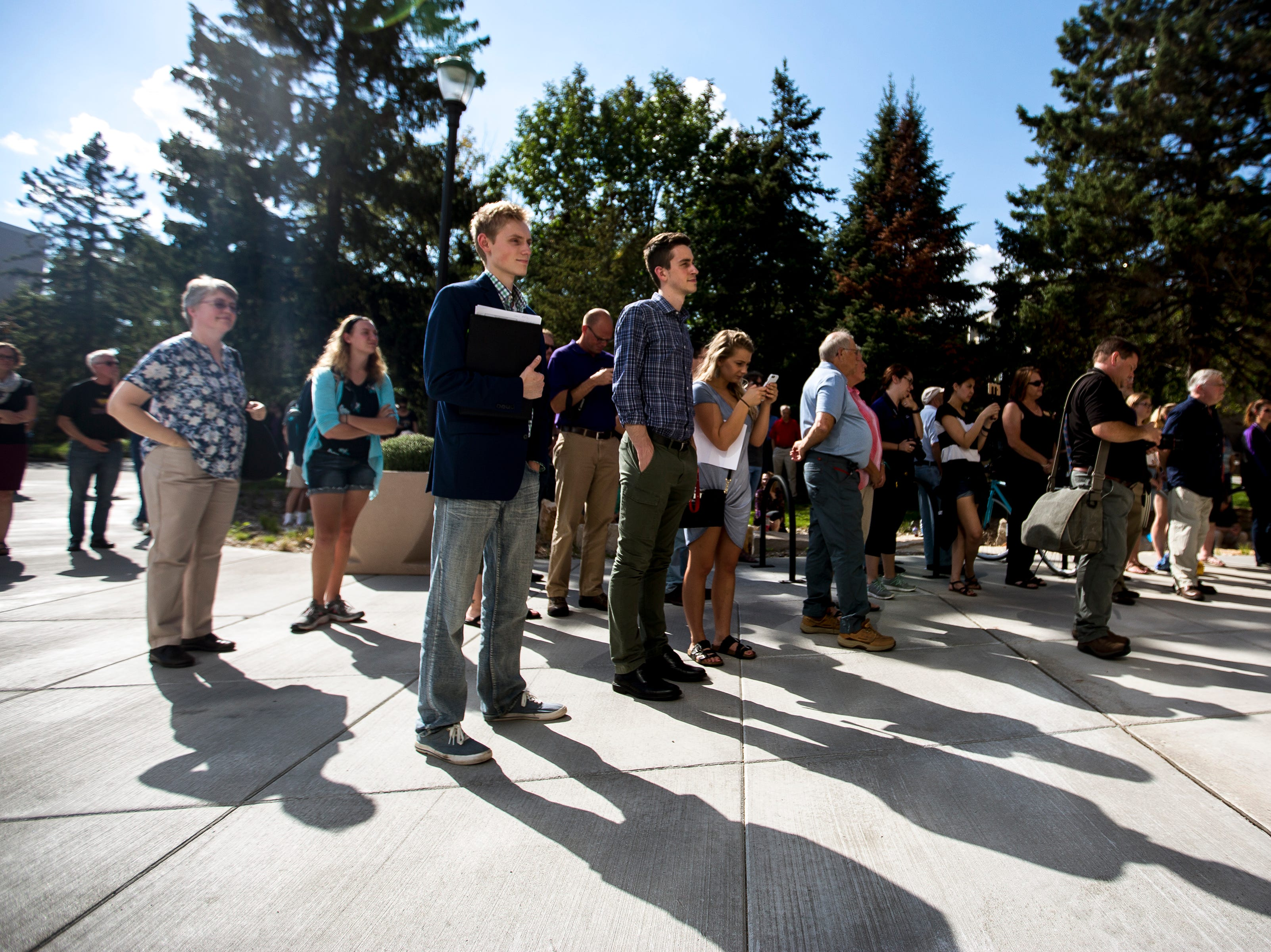 People listen to speakers during the opening ceremony for the Chemistry Biology Building at the University of Wisconsin-Stevens Point in Stevens Point, Wis., Sept. 14, 2018.