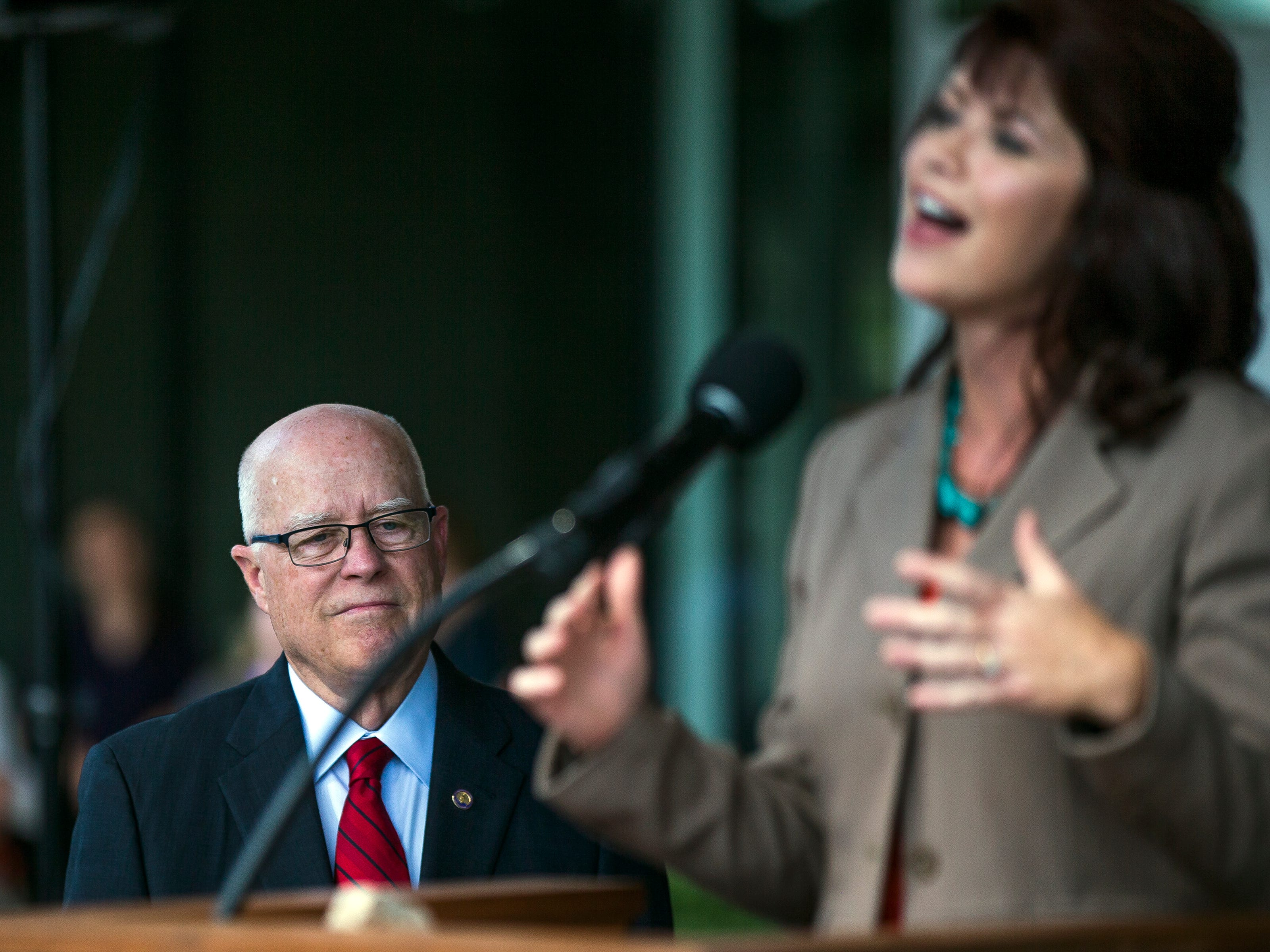 Chancellor Bernie Patterson listens as Lt. Gov. Rebecca Kleefisch speaks during the opening ceremony for the Chemistry Biology Building at the University of Wisconsin-Stevens Point in Stevens Point, Wis., Sept. 14, 2018.