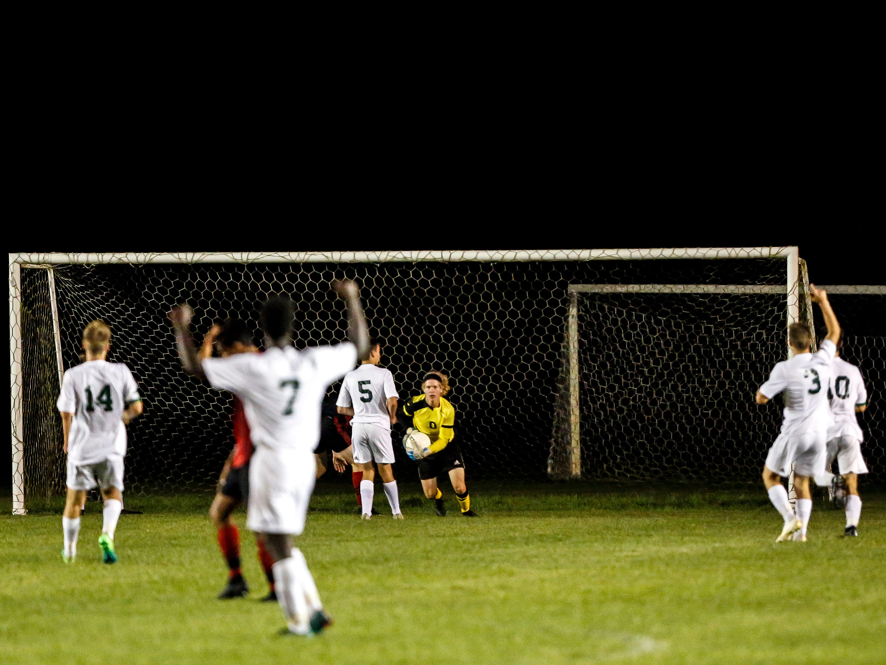 D.C. Everest goalkeeper Ty Tretter makes a save in the final few minutes of a soccer game between SPASH and D.C. Everest in Stevens Point, Wis., September 13, 2018.