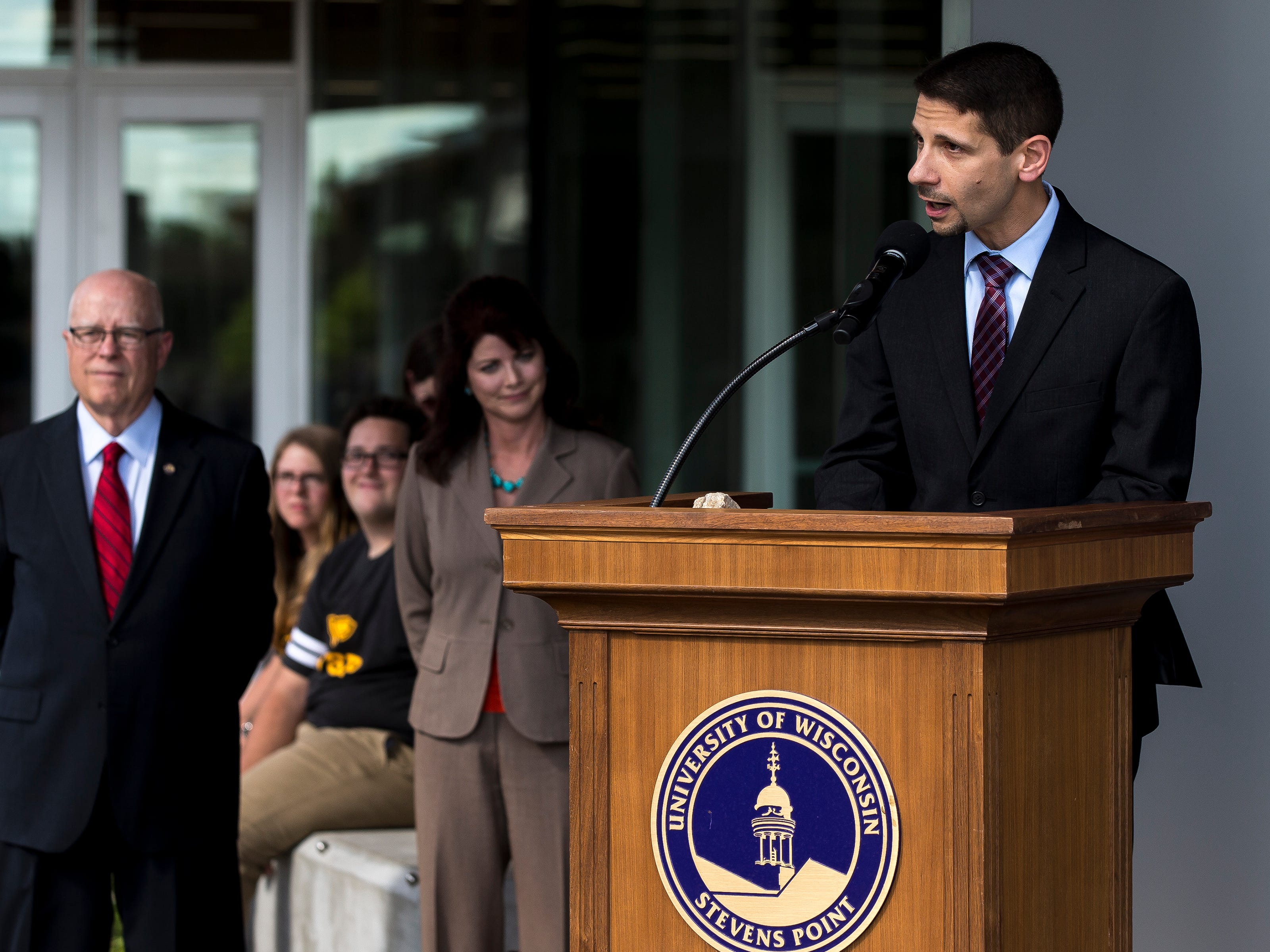 Jason D'Acchioli, professor and chair of the Chemistry Department, speaks during the opening ceremony for the Chemistry Biology Building at the University of Wisconsin-Stevens Point in Stevens Point, Wis., Sept. 14, 2018.
