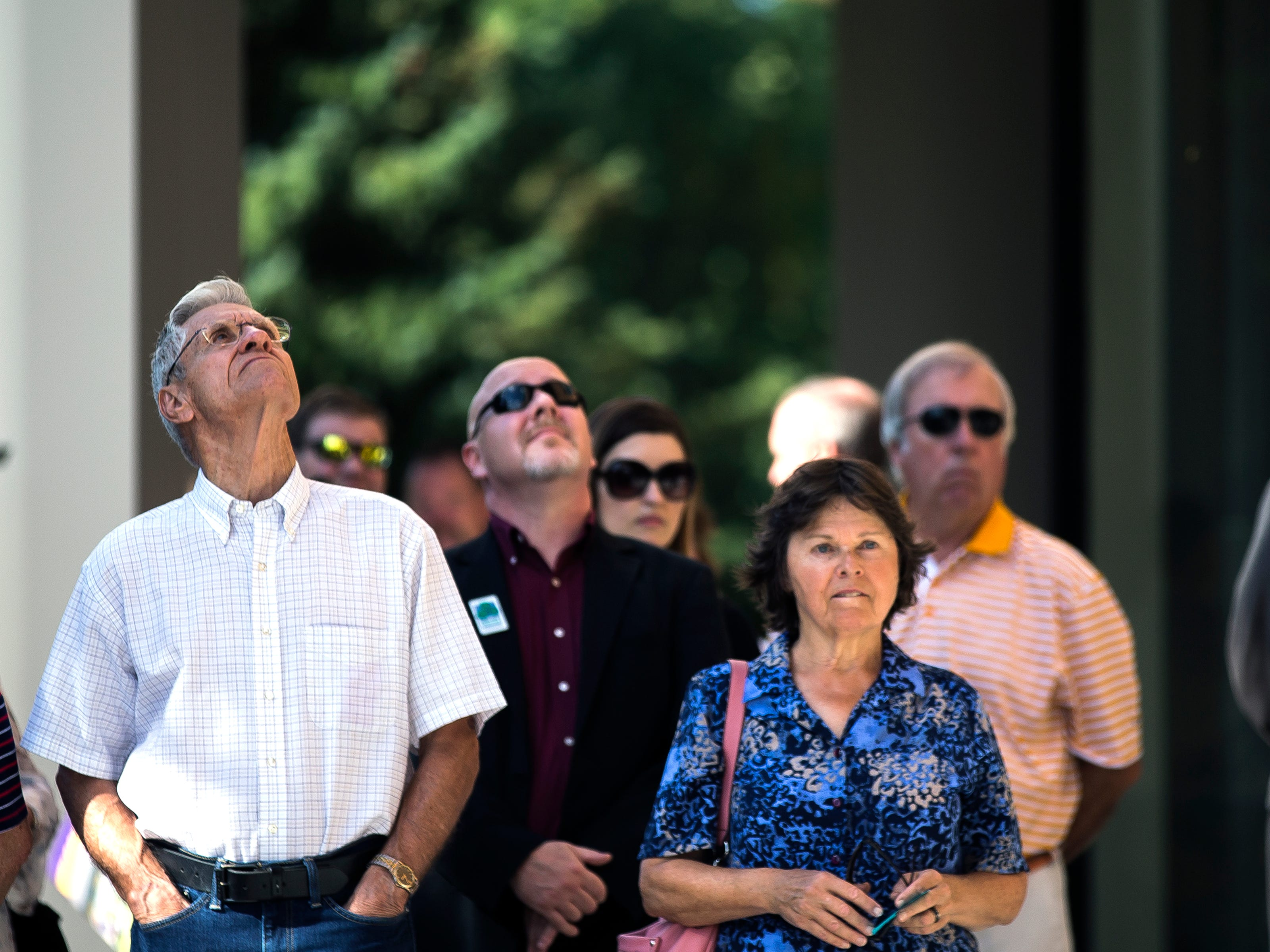 Attendees look at the architecture of the Chemistry Biology Building at the University of Wisconsin-Stevens Point during the opening ceremony in Stevens Point, Wis., Sept. 14, 2018.