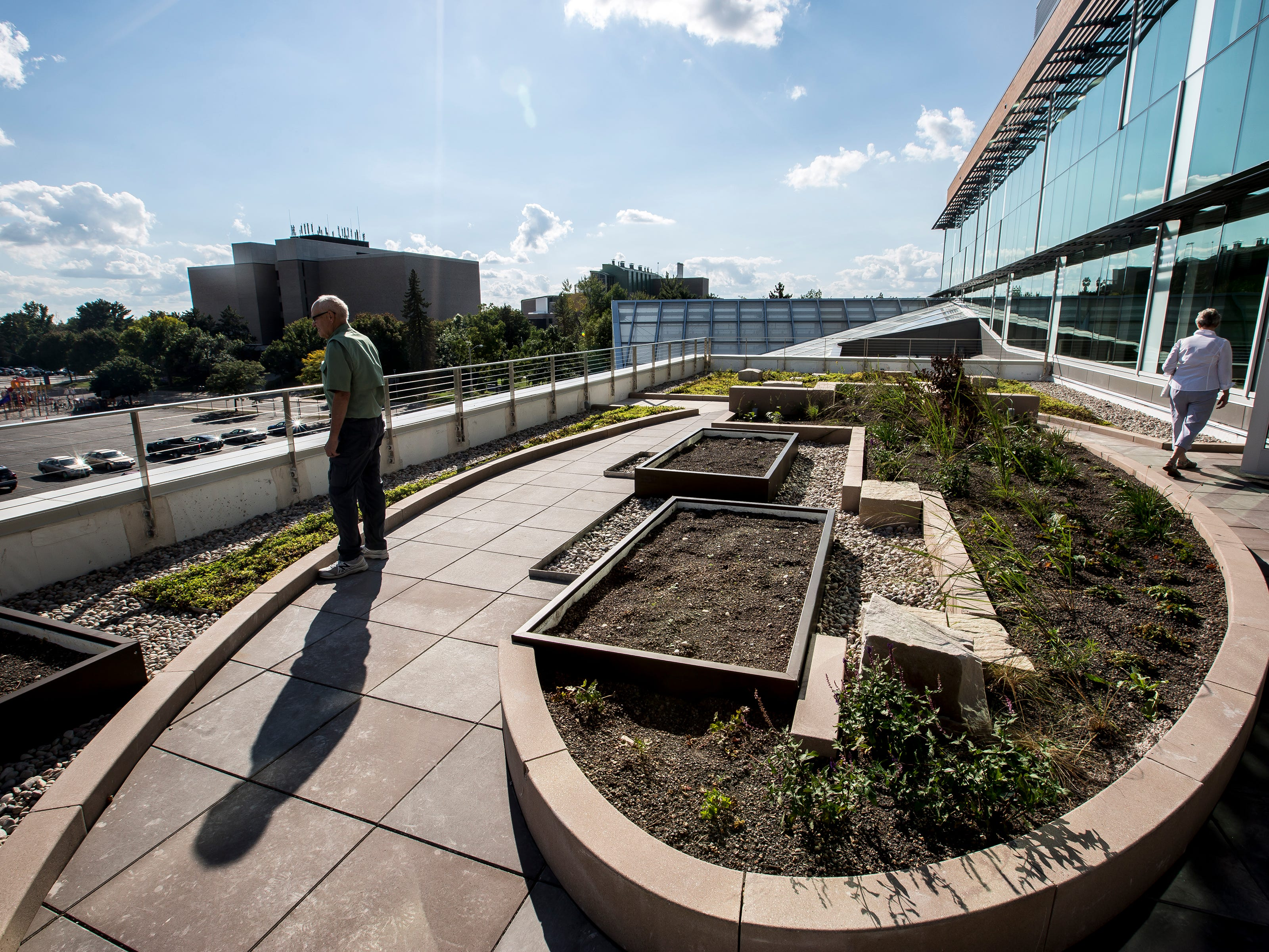 Attendees look at a green roof on the third floor, which was funded by student fees and program revenue, during a tour of the Chemistry Biology Building at the University of Wisconsin-Stevens Point in Stevens Point, Wis., Sept. 14, 2018.