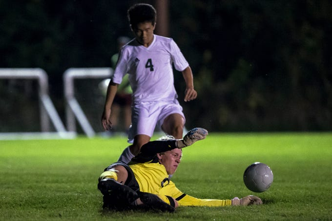 D.C. Everest goalkeeper Ty Tretter makes a save during a soccer game between SPASH and D.C. Everest in Stevens Point, Wis., September 13, 2018.