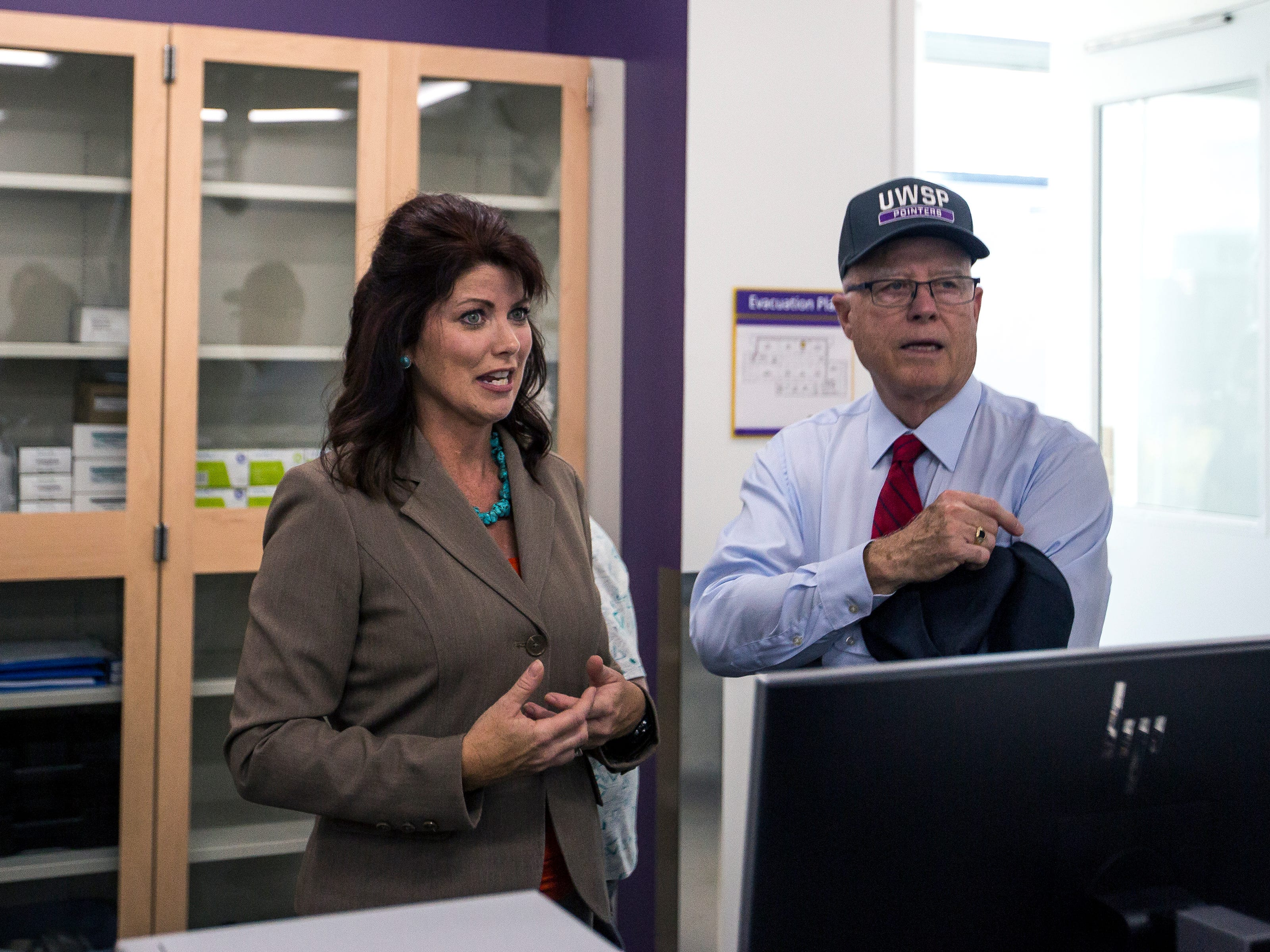 Lt. Gov. Rebecca Kleefisch, left, and Chancellor Bernie Patterson tour a laboratory in the Chemistry Biology Building at the University of Wisconsin-Stevens Point in Stevens Point, Wis., Sept. 14, 2018.