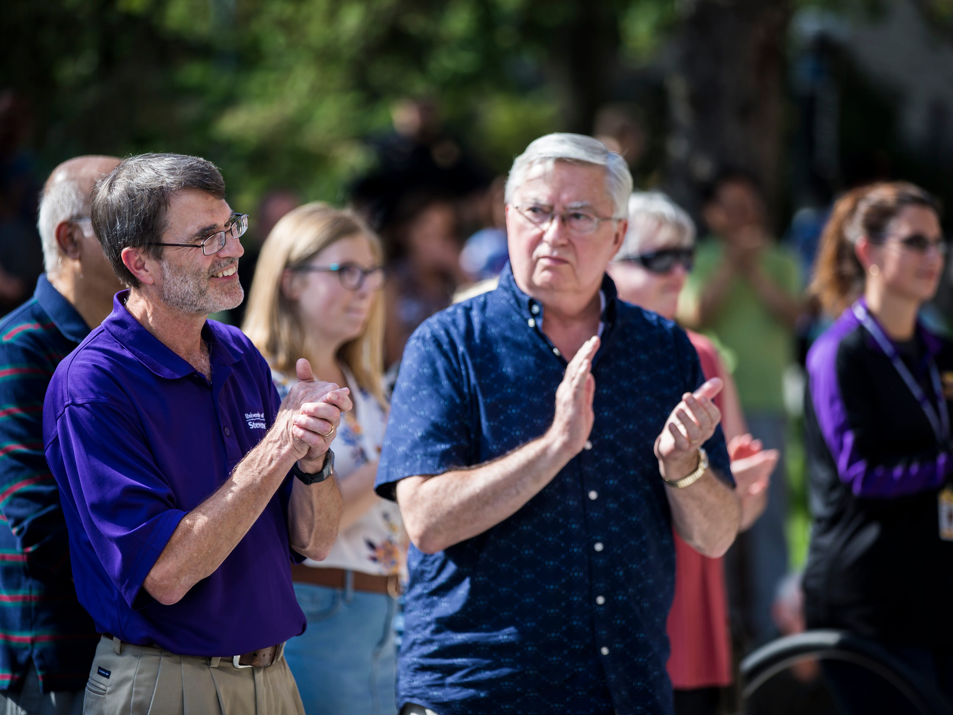 People react to a speaker's comments during the opening ceremony for the Chemistry Biology Building at the University of Wisconsin-Stevens Point in Stevens Point, Wis., Sept. 14, 2018.