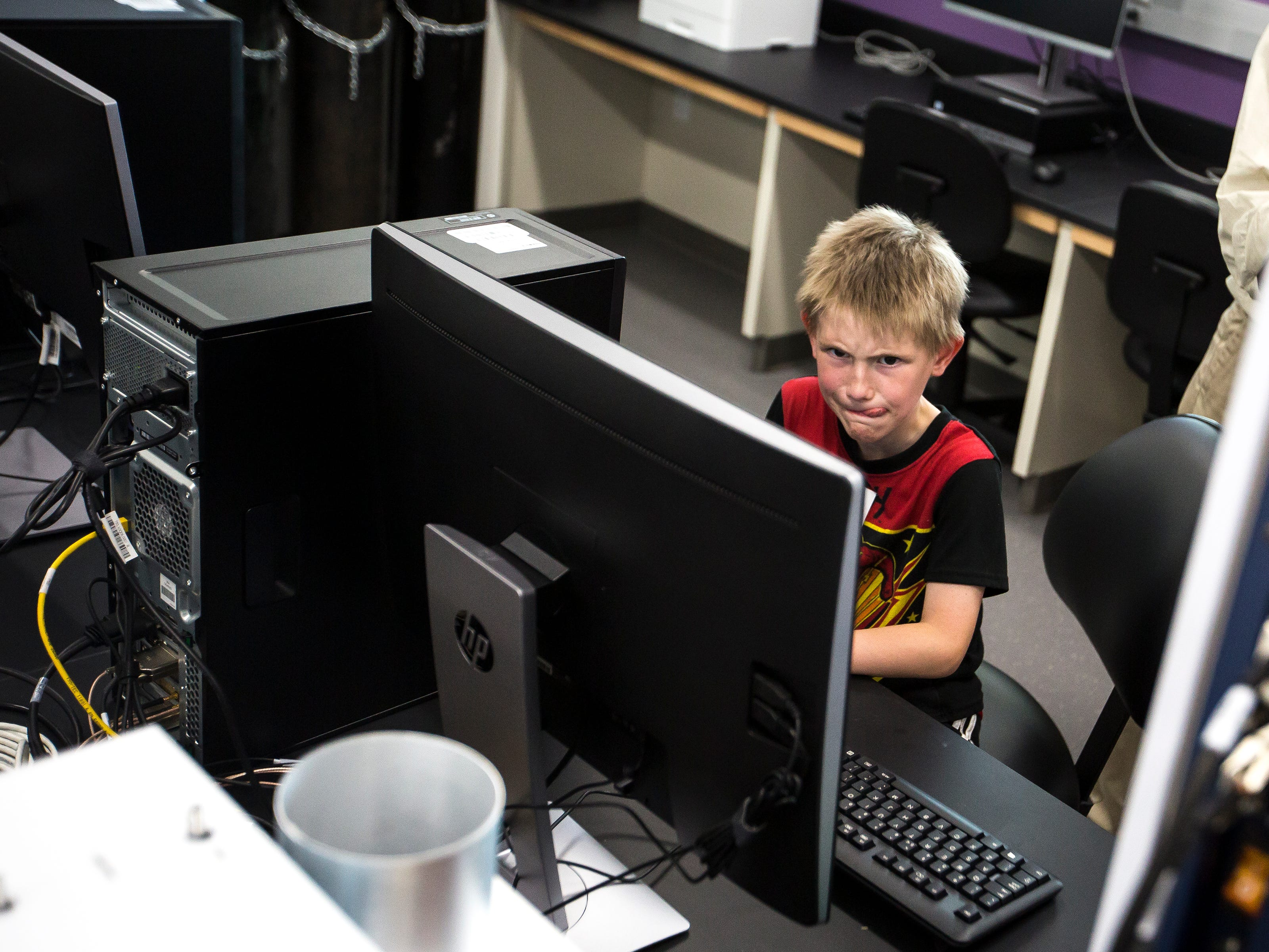 Hunter Olson-Megee of Junction City uses a computer to control a mass spectrometer used to identify unknown molecules during a tour of the Chemistry Biology Building at the University of Wisconsin-Stevens Point in Stevens Point, Wis., Sept. 14, 2018.