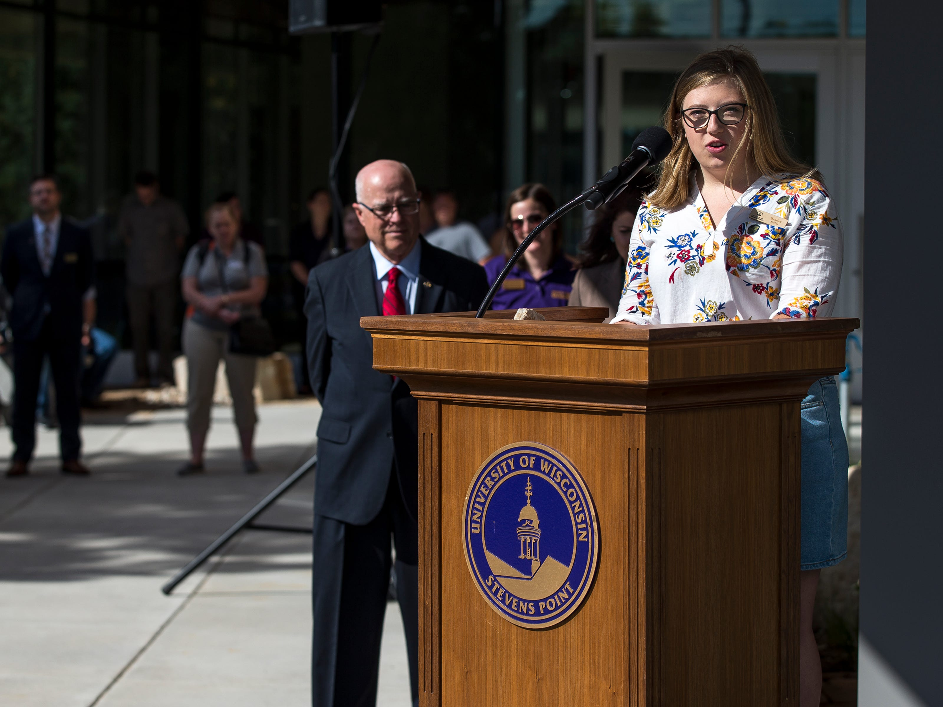 Brailey Kerber, the Student Government Association president, speaks during the opening ceremony for the Chemistry Biology Building at the University of Wisconsin-Stevens Point in Stevens Point, Wis., Sept. 14, 2018.