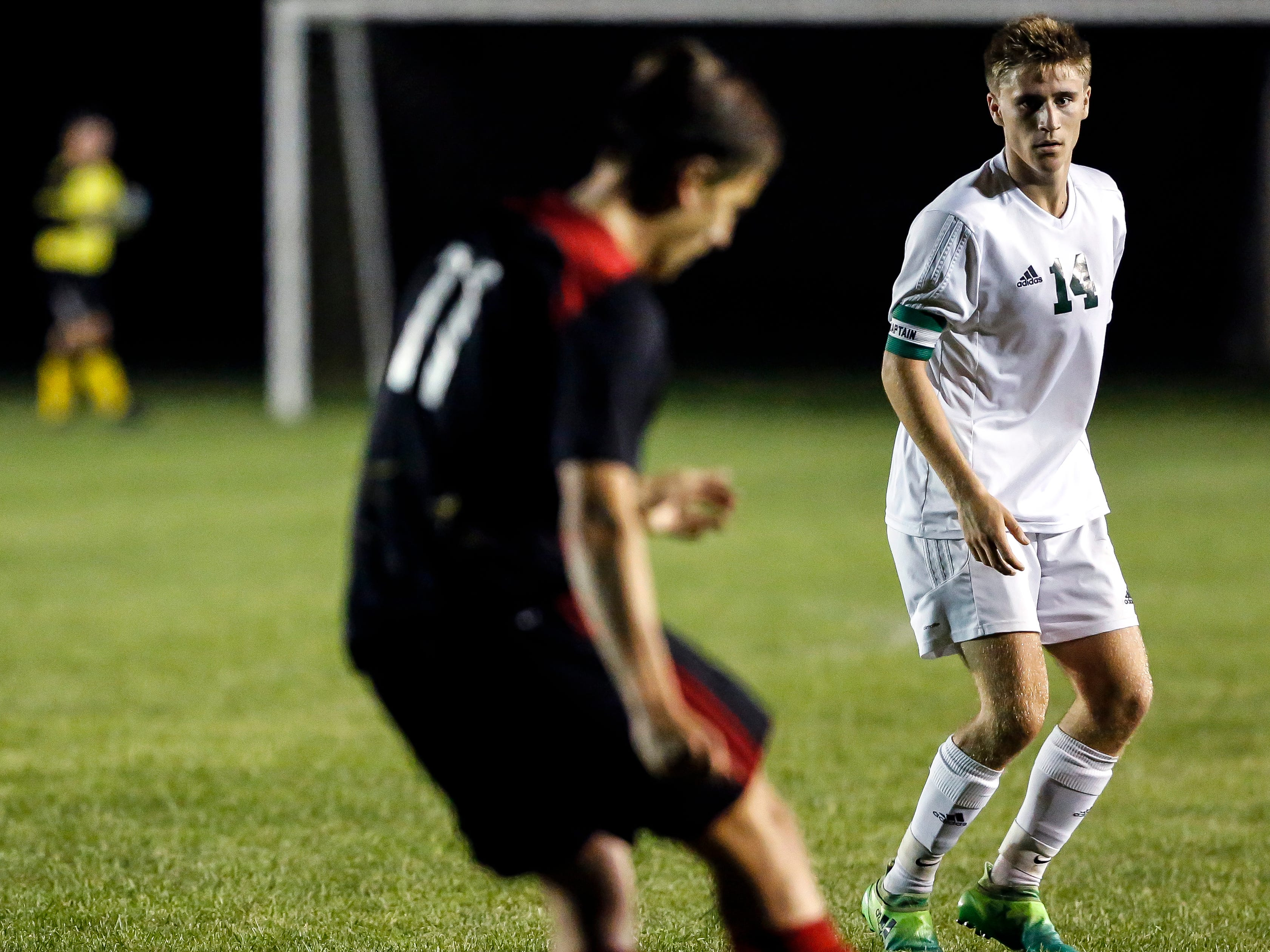 Brendan Leahy of SPASH prepares to kick the ball down the field as D.C. Everest's Ethan Stashek looks on during a soccer game between SPASH and D.C. Everest in Stevens Point, Wis., September 13, 2018.