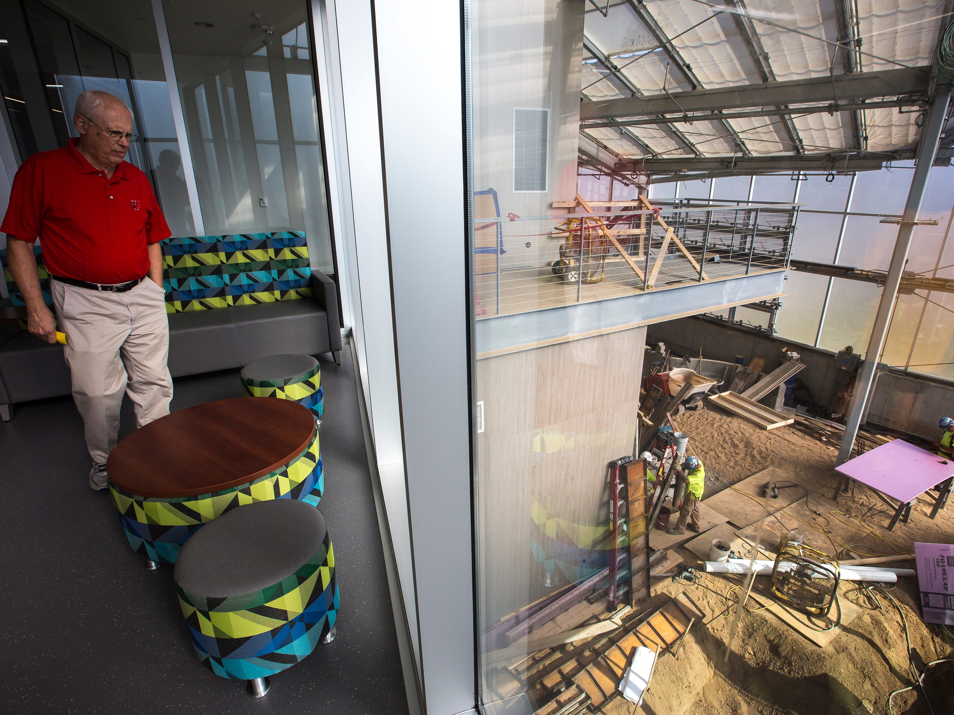 A man looks at construction being done on the tropical conservatory, which is scheduled to open later in the fall, during a tour of the Chemistry Biology Building at the University of Wisconsin-Stevens Point in Stevens Point, Wis., Sept. 14, 2018.
