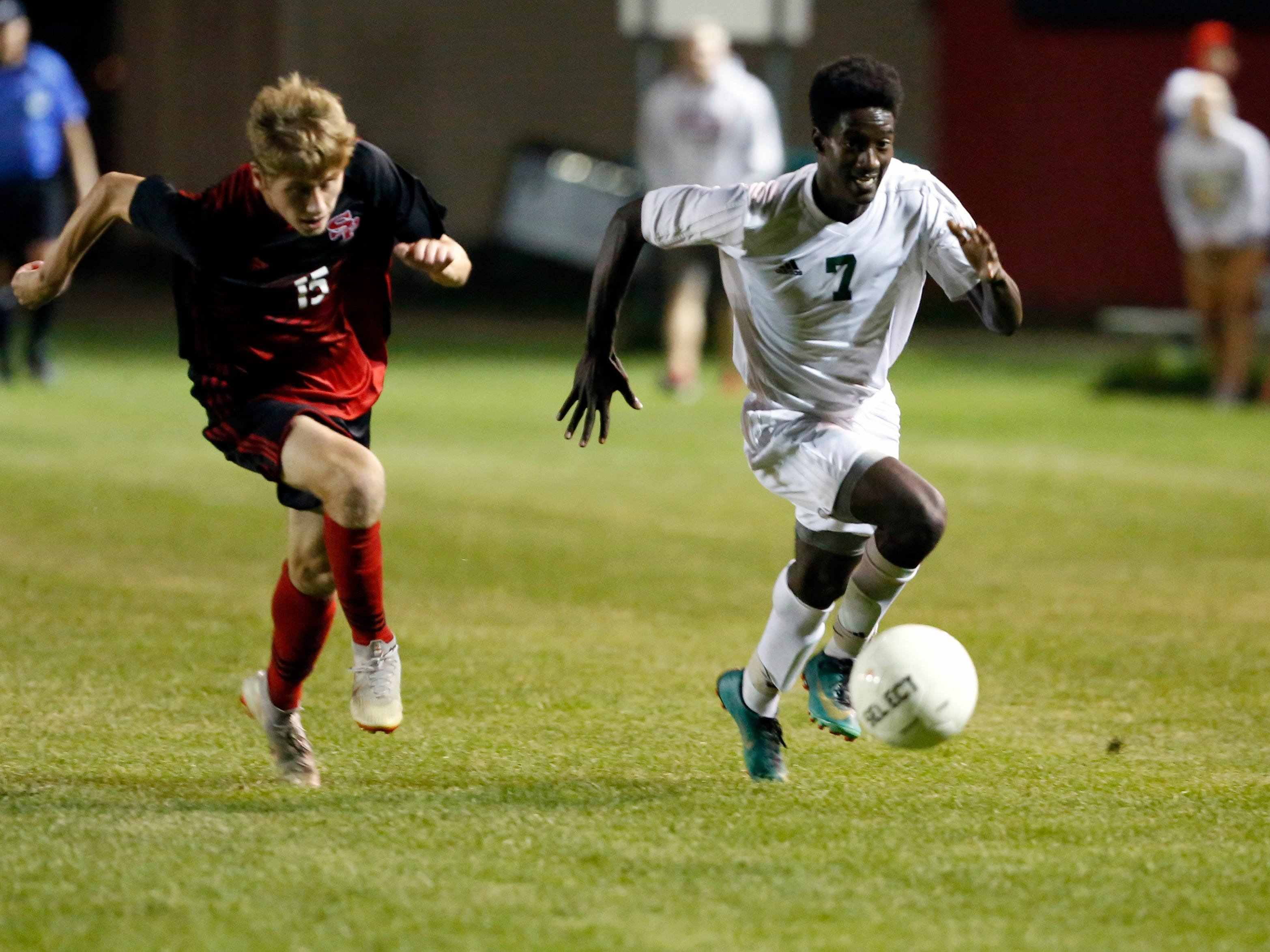 D.C. Everest player Tamirat Knutson makes a run trailed by SPASH player Marshall Sallet during a soccer game between SPASH and D.C. Everest in Stevens Point, Wis., September 13, 2018.
