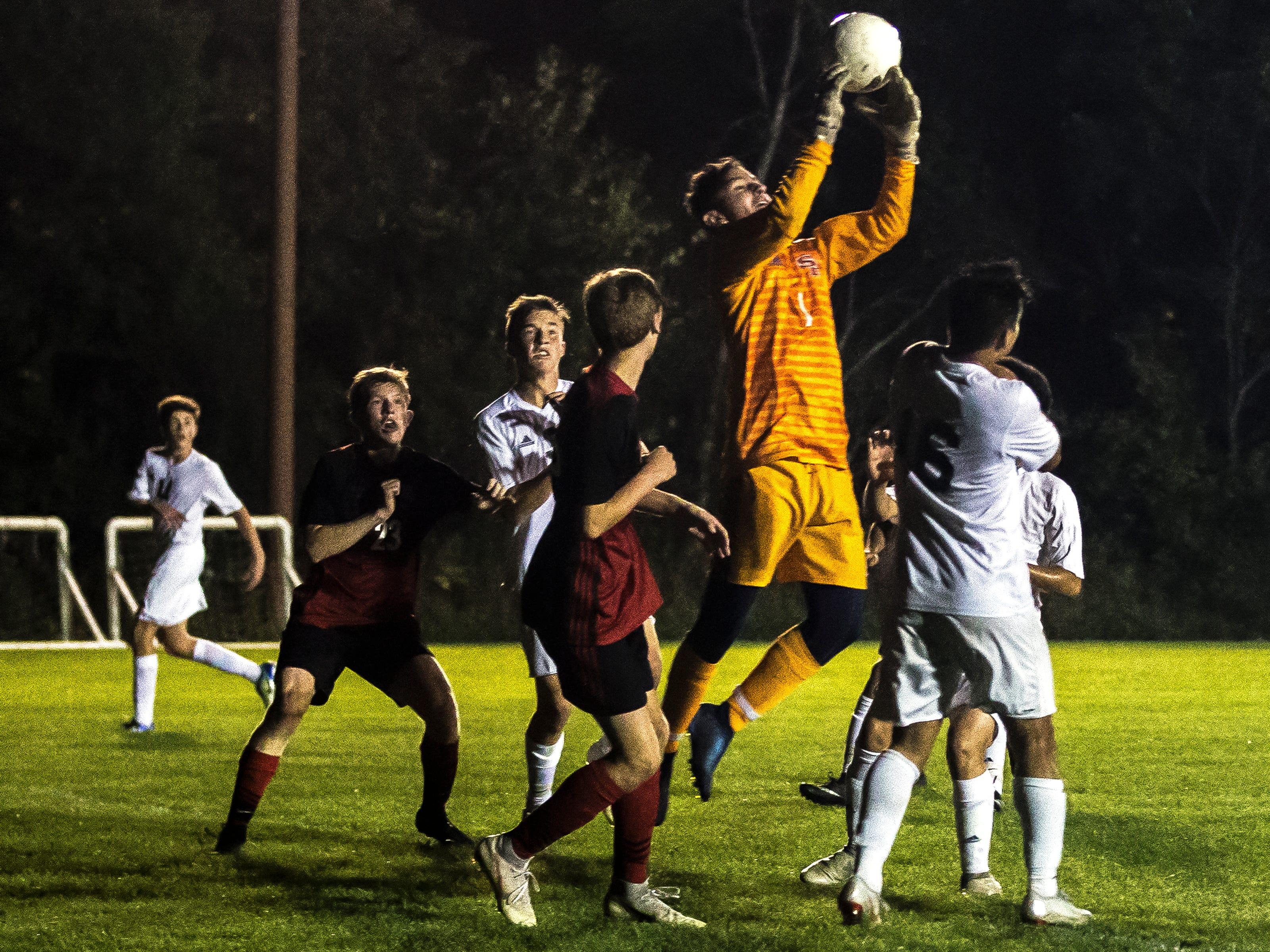 SPASH goalkeeper Spencer Banks makes a save during a soccer game between SPASH and D.C. Everest in Stevens Point, Wis., September 13, 2018.