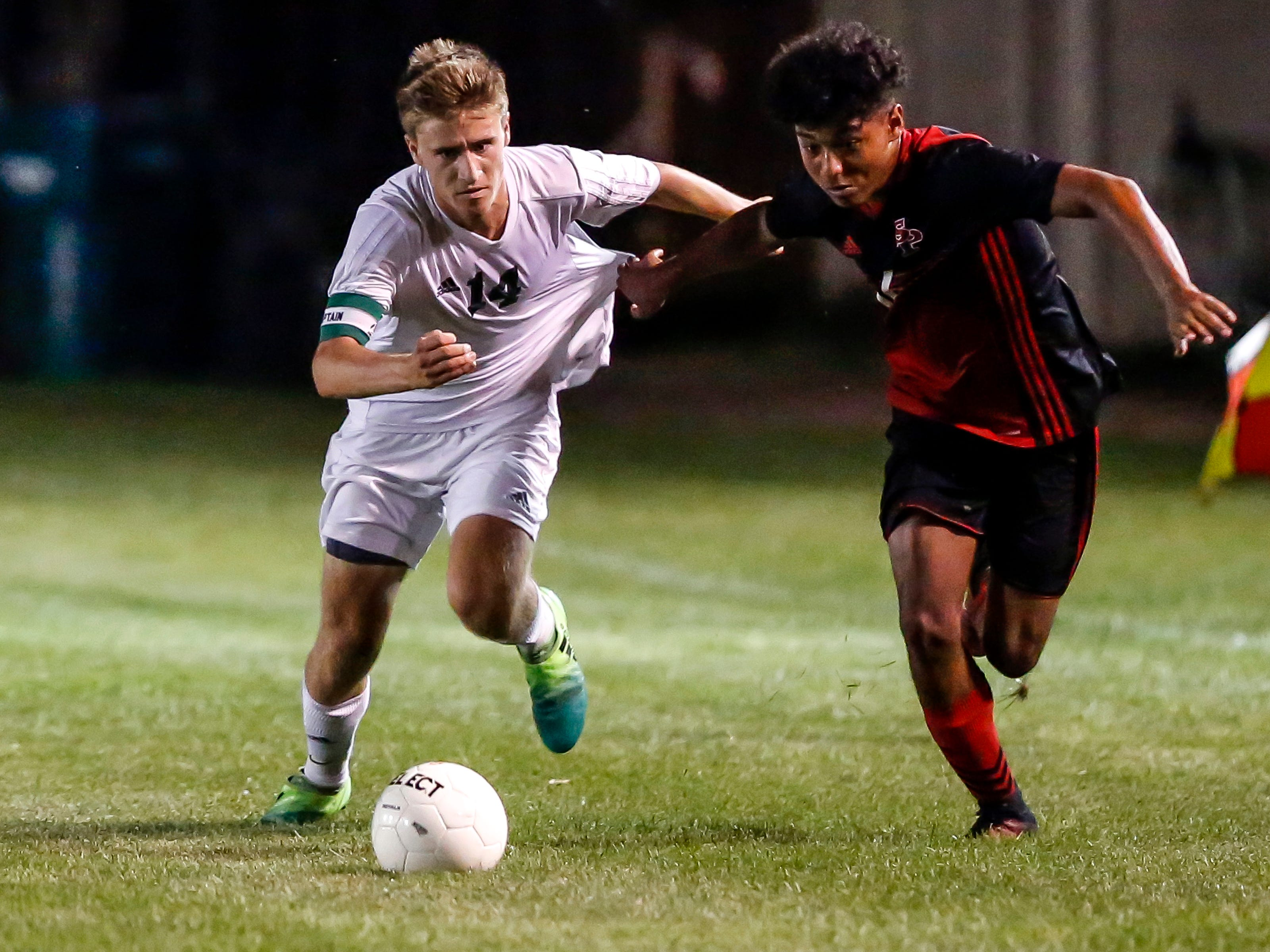 Ethan Stashek of D.C. Everest and Lio Perkins fight for control of the ball during a soccer game between SPASH and D.C. Everest in Stevens Point, Wis., September 13, 2018.