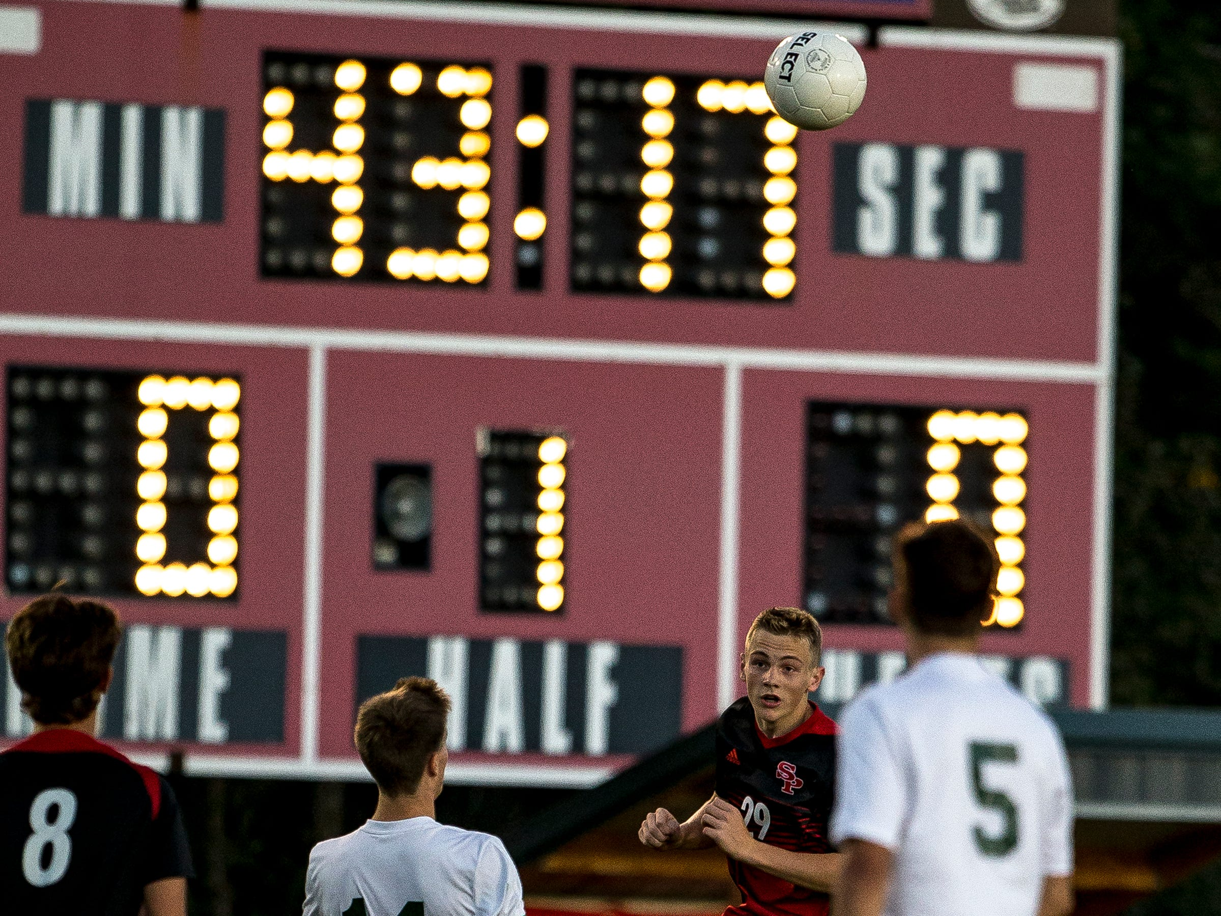SPASH player Owen Williams heads the ball during a soccer game between SPASH and D.C. Everest in Stevens Point, Wis., September 13, 2018.